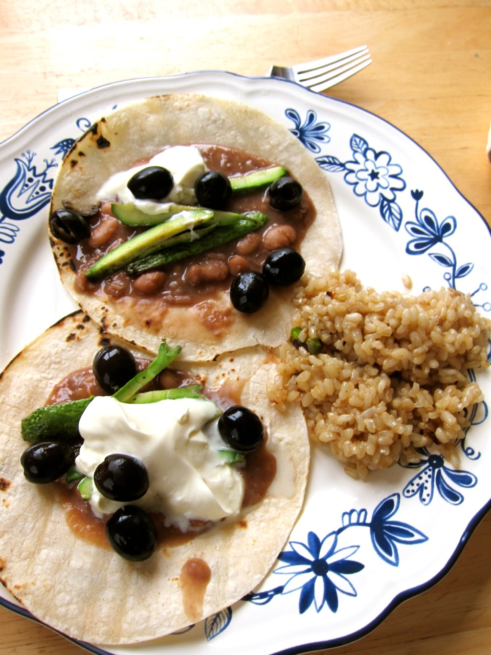Tacos topped with dollops of Plain Angelito are a true summer treat. These simple tacos here also have black olives, roasted zucchini and fresh pinto beans.