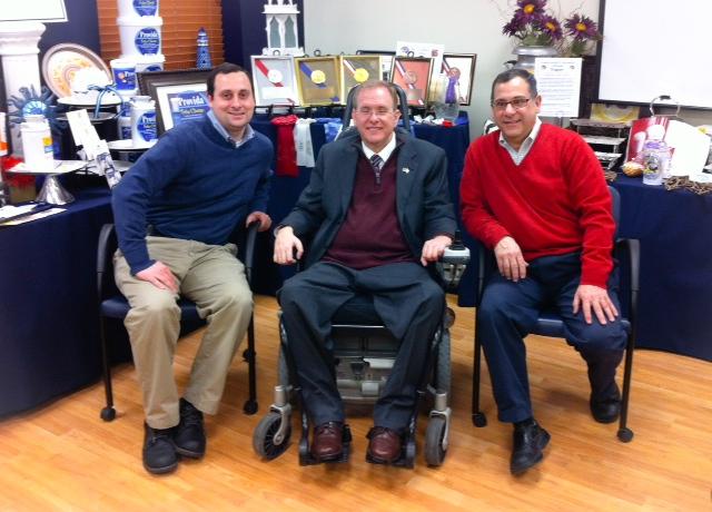 Mark Federico, Jr., Congressman Langevin and Mark Federico, Sr. gather at Narragansett Creamery.
