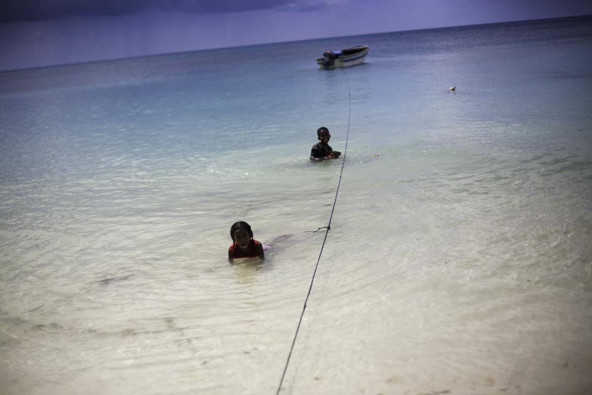 Kids playing in water, Corn Island