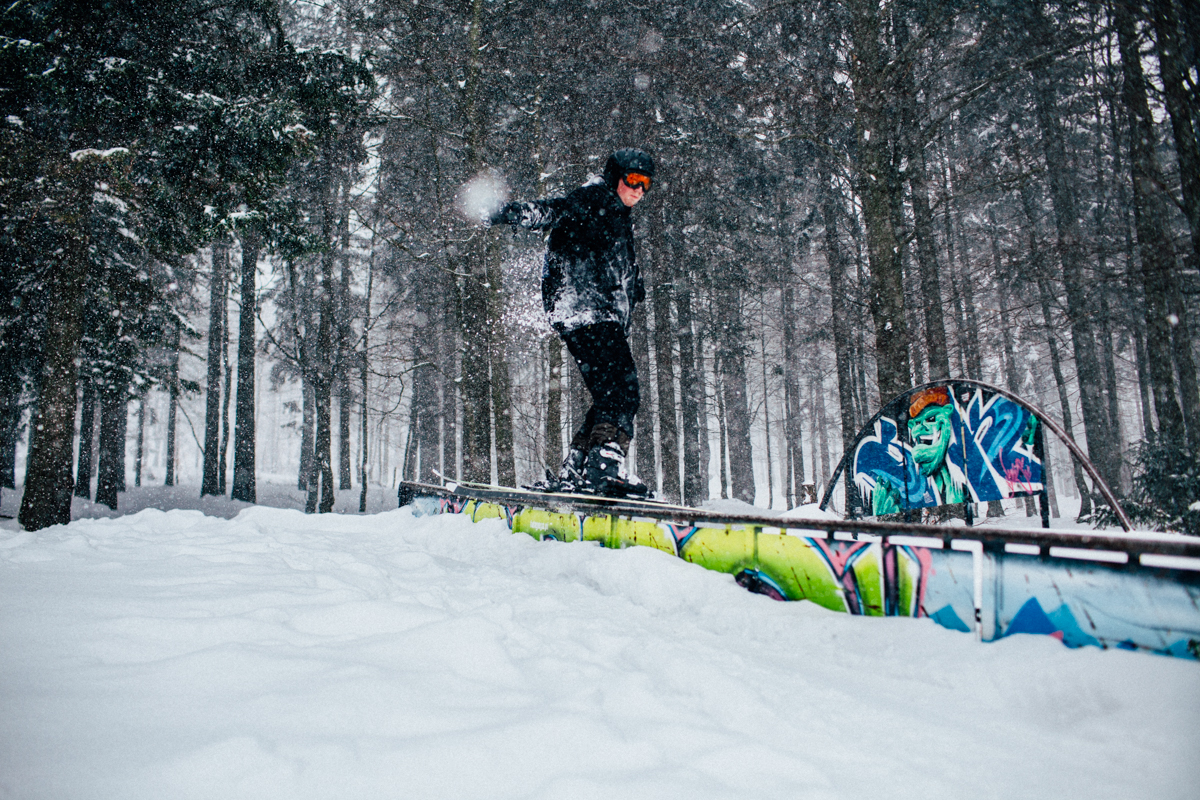 Marcin doing tricks in the snow park. In the background is graffiti by Malik, a homie from my old graffiti crew.