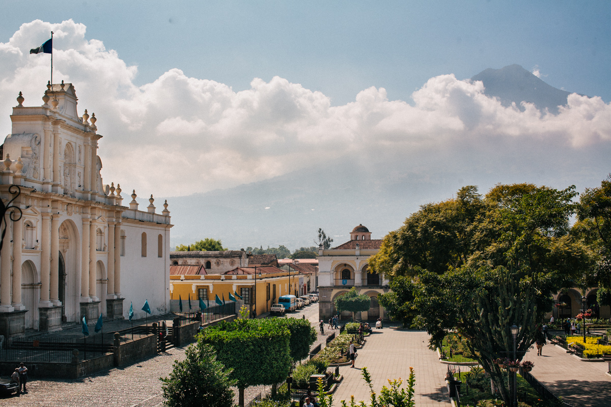 Main Plaza In Antigua Guatemala and Volcano de Agua