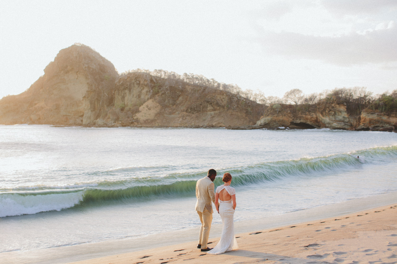 Newly married walking down the beach in Nicaragua. Best wedding photography.