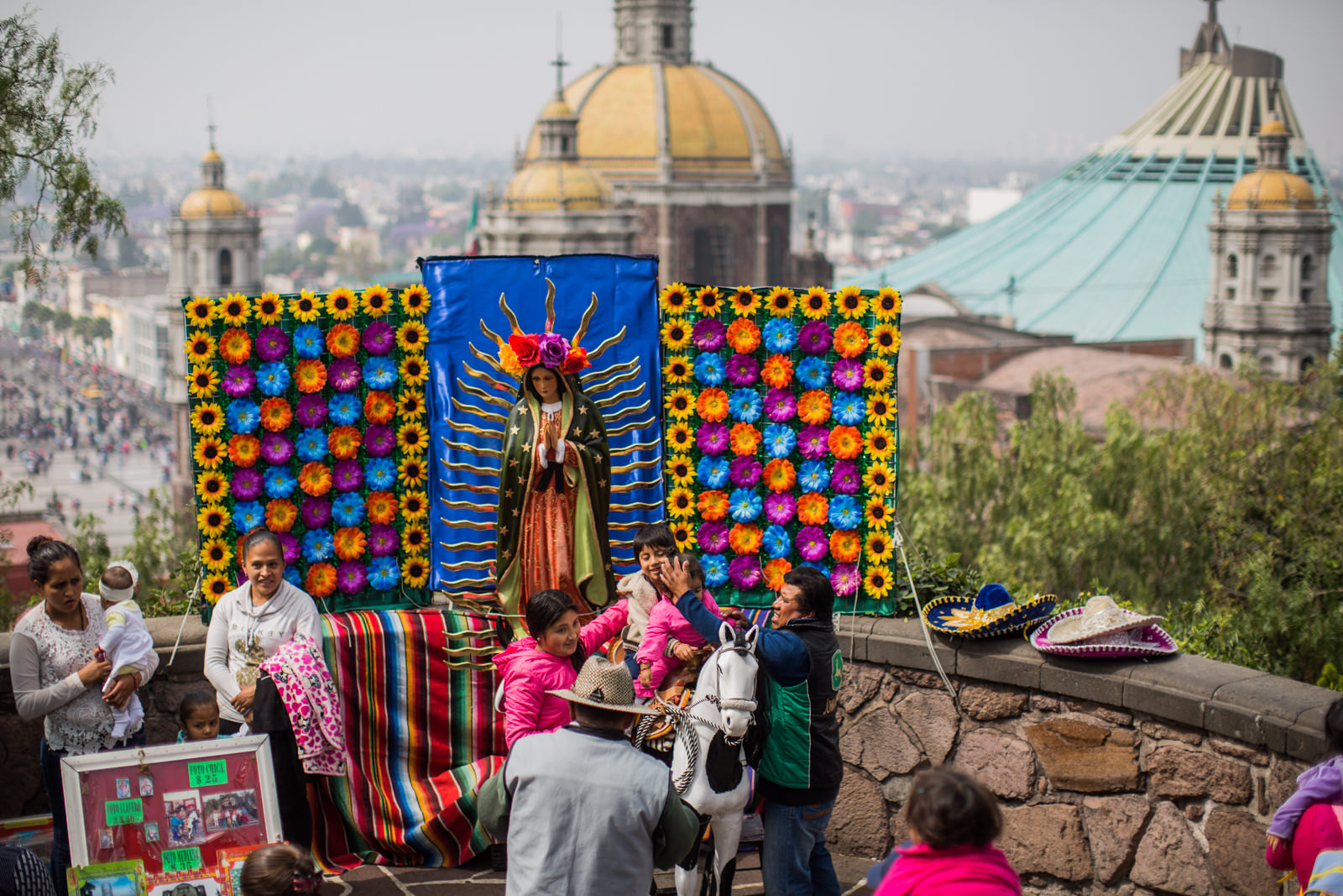 Parents placing their children for a souvenir photo on the background of the   old Basilica of Our Lady of Guadalupe   - one of the most visited Catholic Shrines in the world and the National Shrine of Mexico. That's where Our Lady of Guadalupe, or the Virgin Mary, is believed to have appeared to a Native American peasant named Juan Diego in 1531.