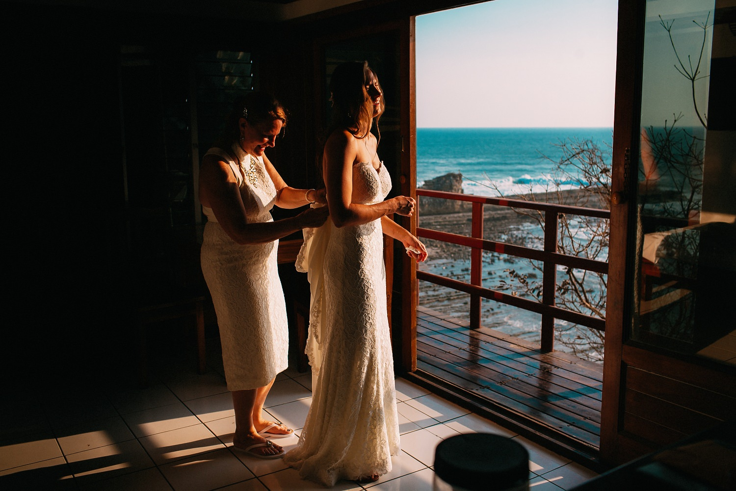 Mother helping the bride before her beach wedding. Popoyo, Nicaragua