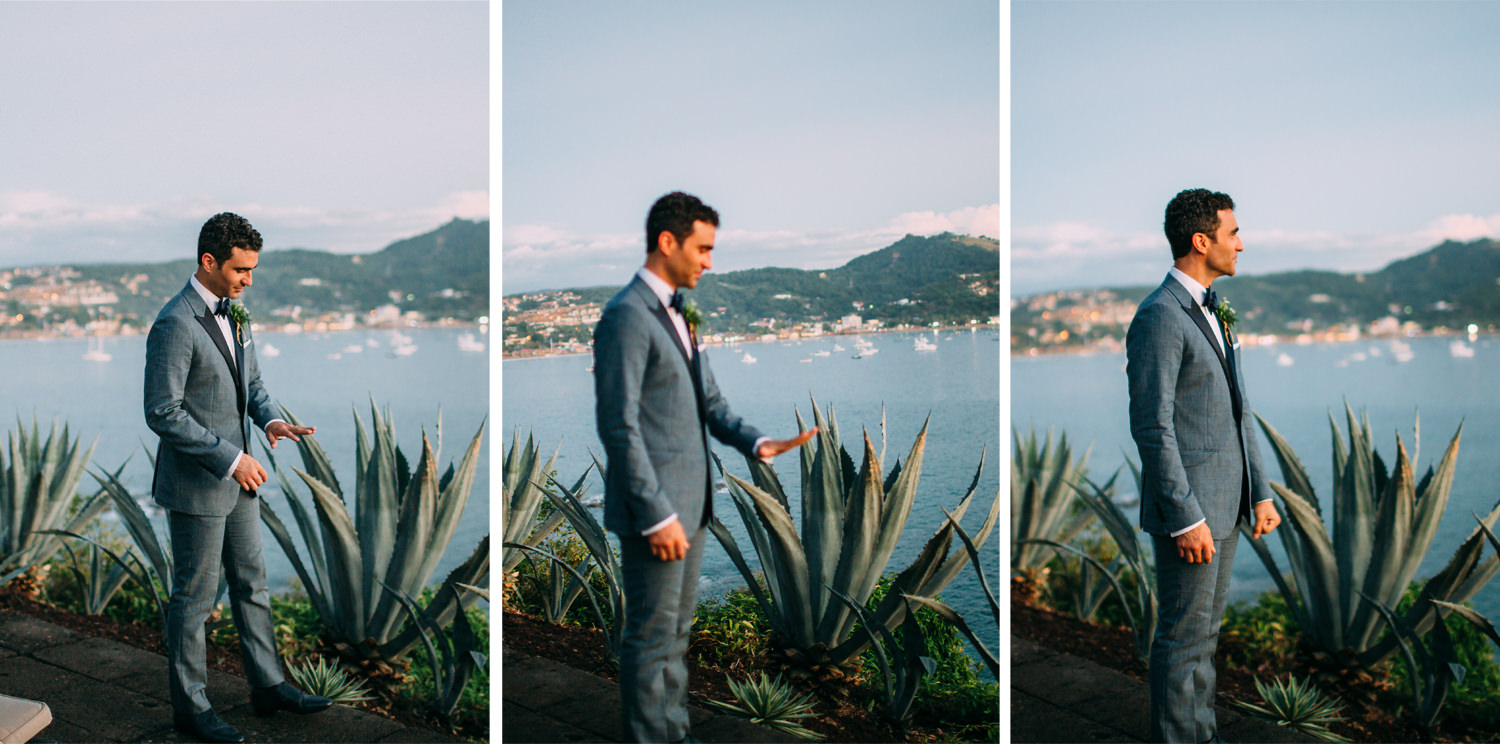The Groom admires his ring just after he got married. In the background San Juan Del Sur Bay at dusk.