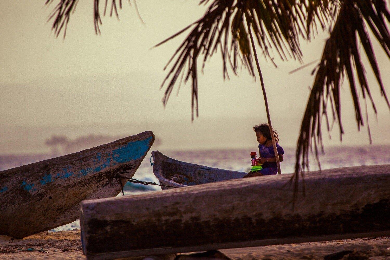 San blas Island- kuna girl playing among canoes-Exposure.jpg