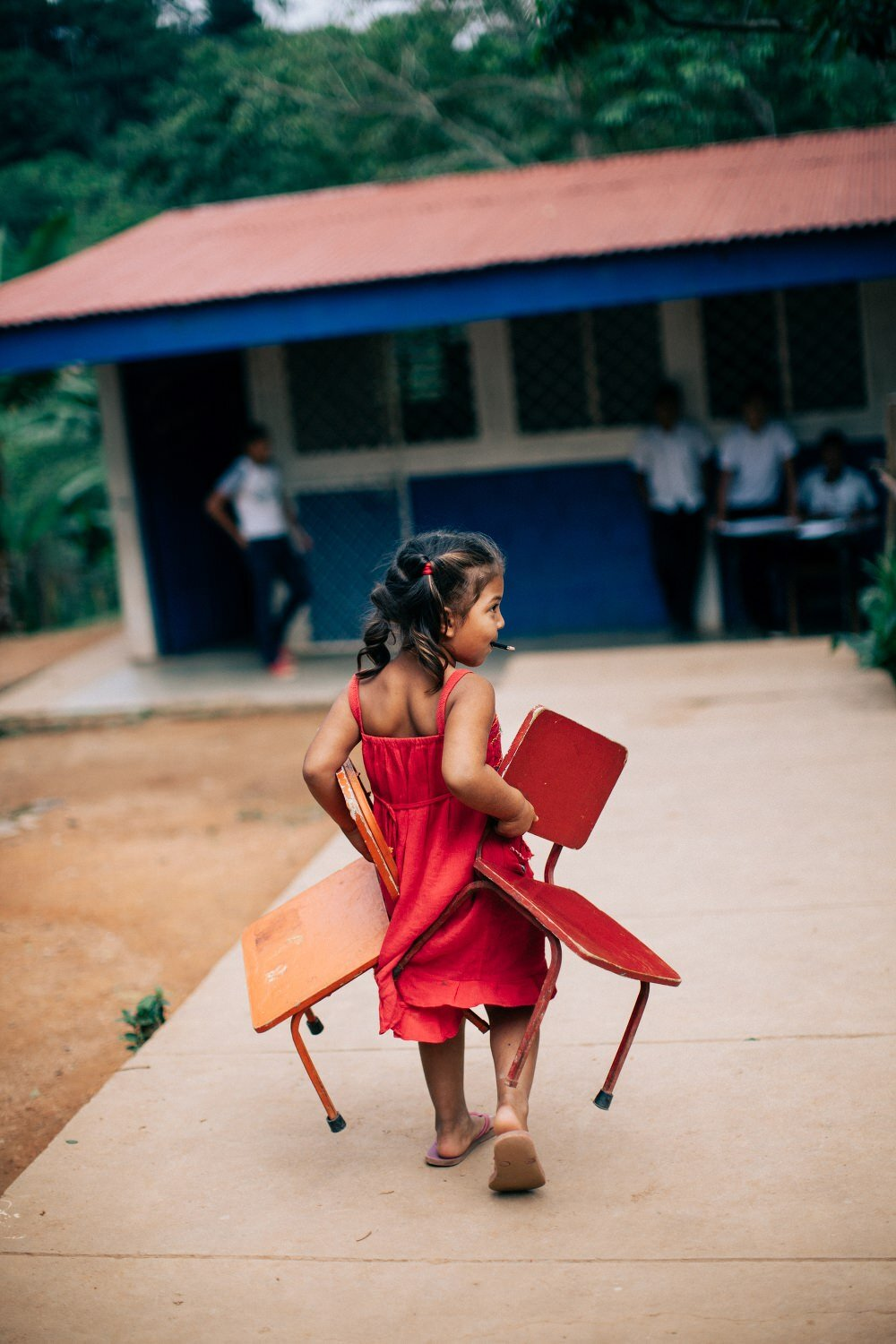 little girl with chairs in schoollittle girl with chairs in school.jpg