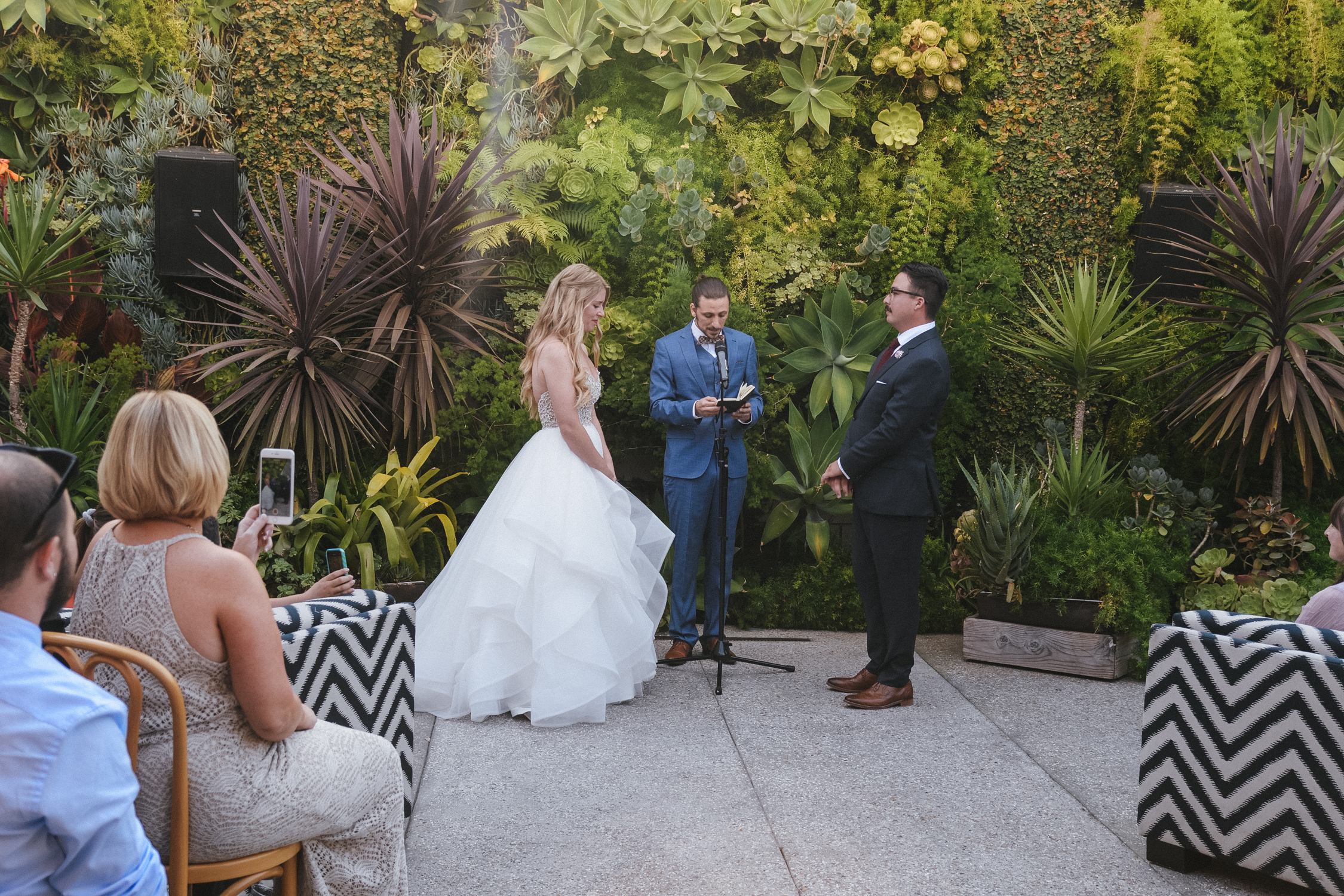 The ceremony backdrop was an incrdible live wall with succulents and other tropical plants. No need for an arch with this beauty.
