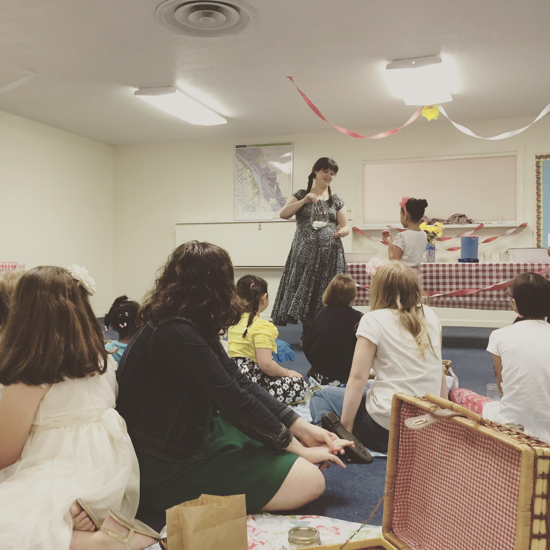 Allix teaching a devotional