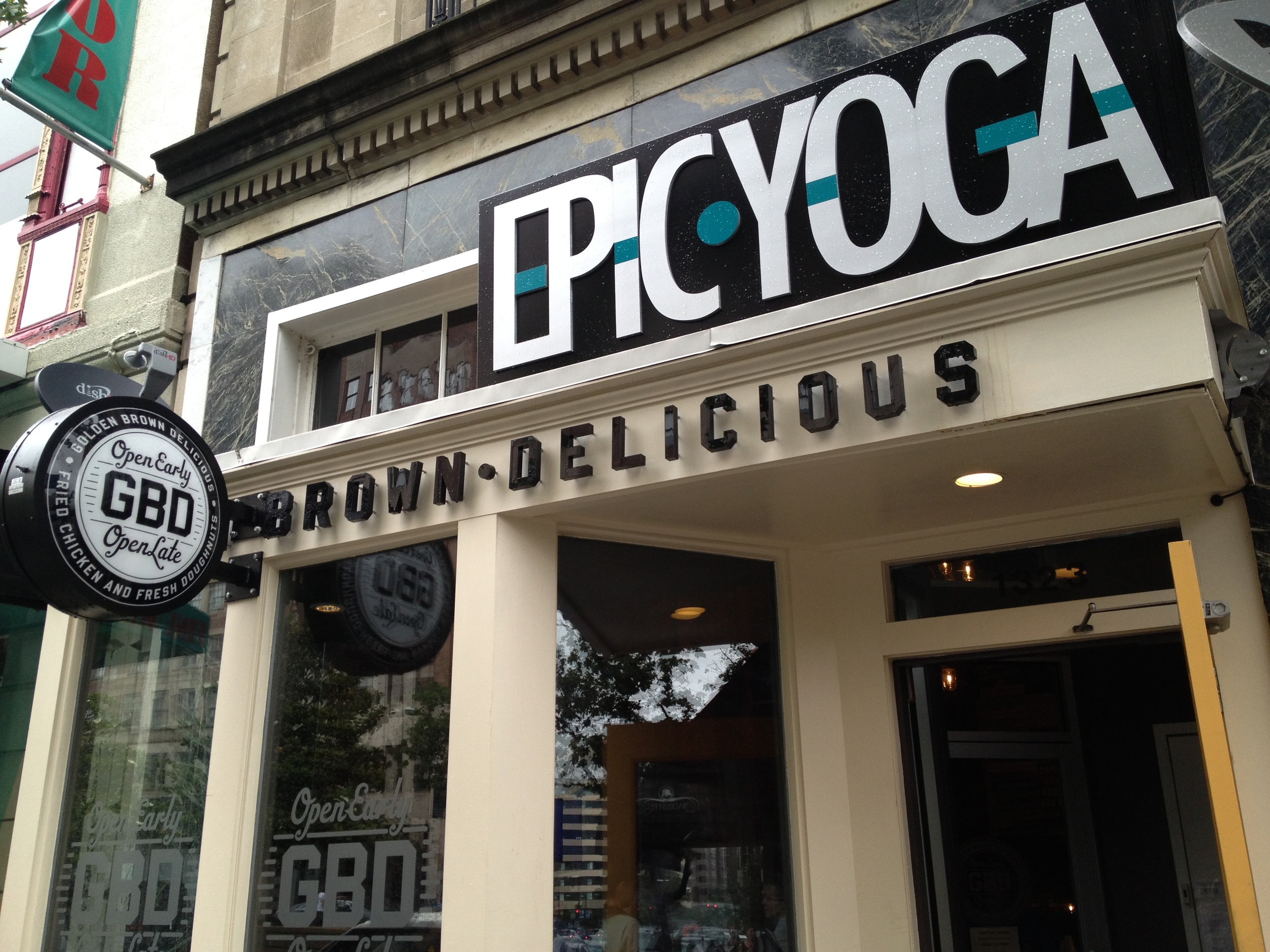 Spotted near Dupont Circle: Yoga studio above donut-and-fried-chicken joint! Balance, much?