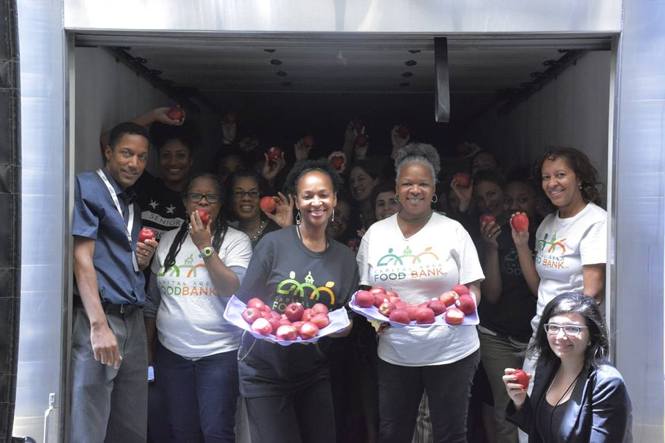 My coworkers and I squeezing into a produce truck to celebrate Giant's recent donation of 10,000 apples