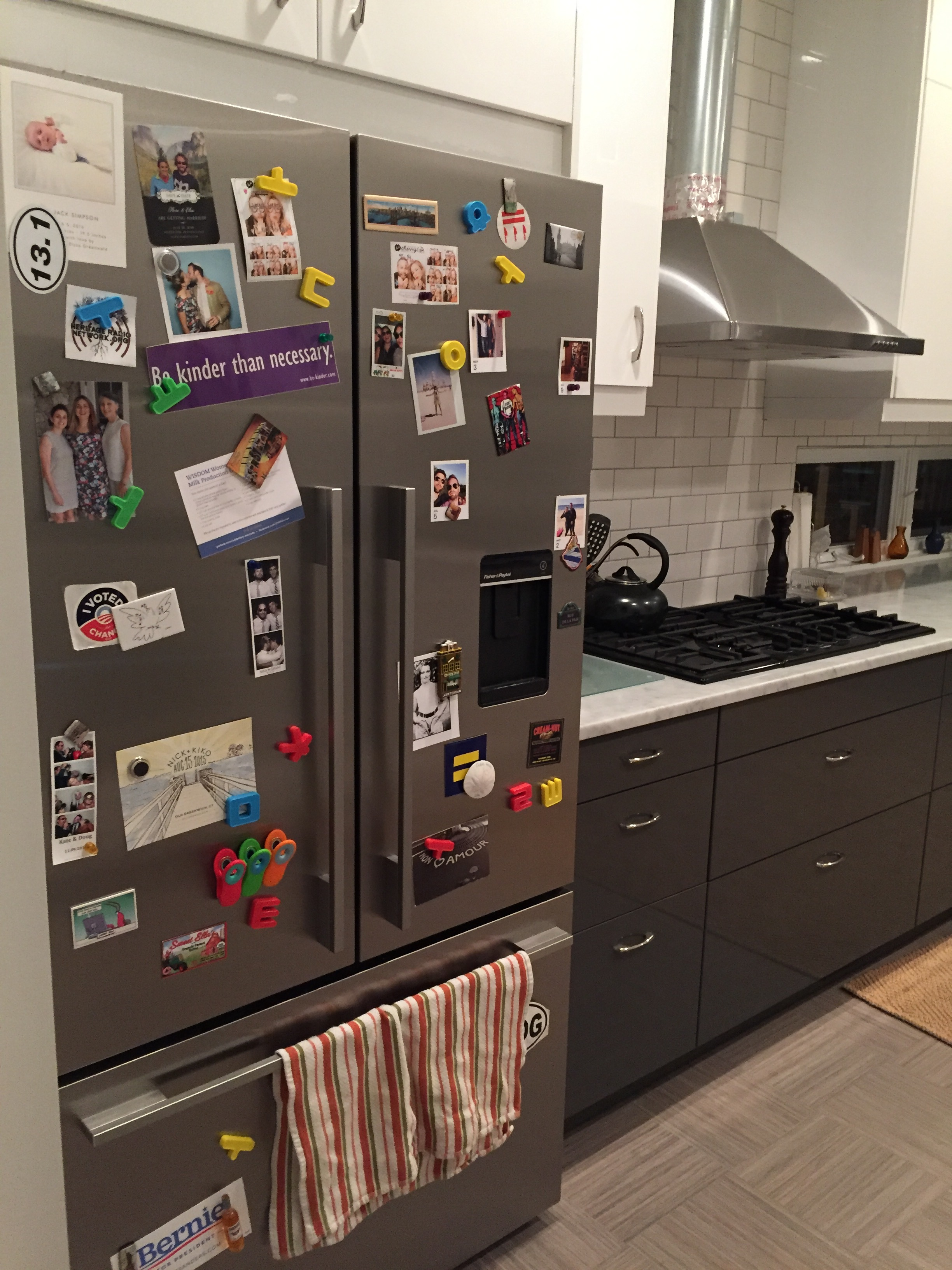 "Yes, the kitchen is pretty white--I think that's how we Bourne women like it. So we've been adding the Renzbo ""collector's touch"", like with our hodgepodge fridge back in action (chose this Fisher & Paykel model because it's magnetic.)"