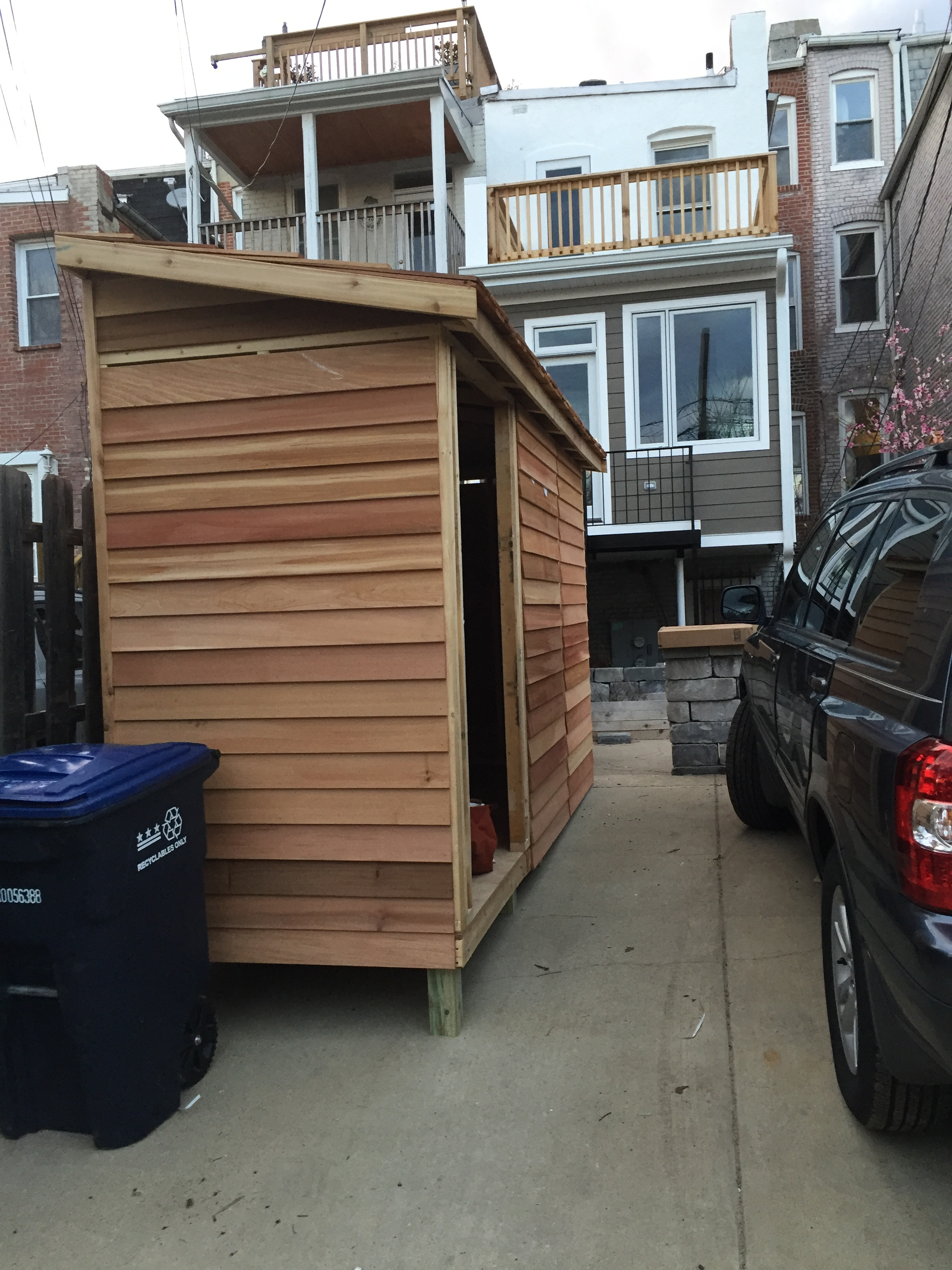 The new Canadian cedar bike shed was constructed from a kit--notice our new deck on the second floor above the kitchen.