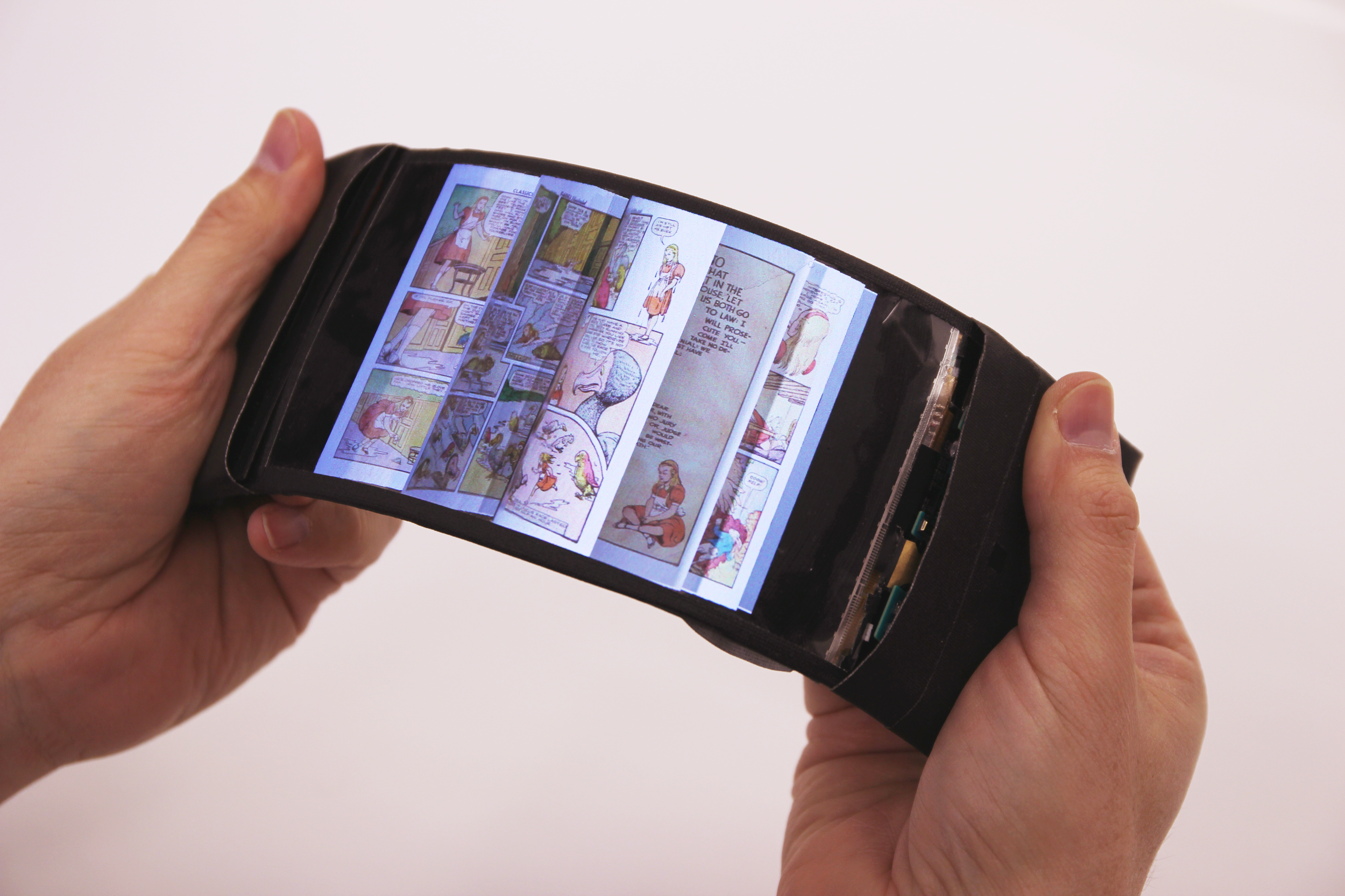 ReFlex (2016): User navigating pages by bending the smartphone; feels pages flip through fingers.