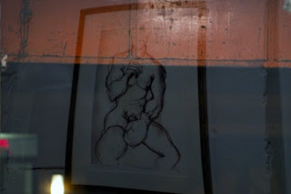 "And another one of Weltman's prints, ""Fight Boy Getting Ready"" (a limited edition print), reflected in the gallery's front window."