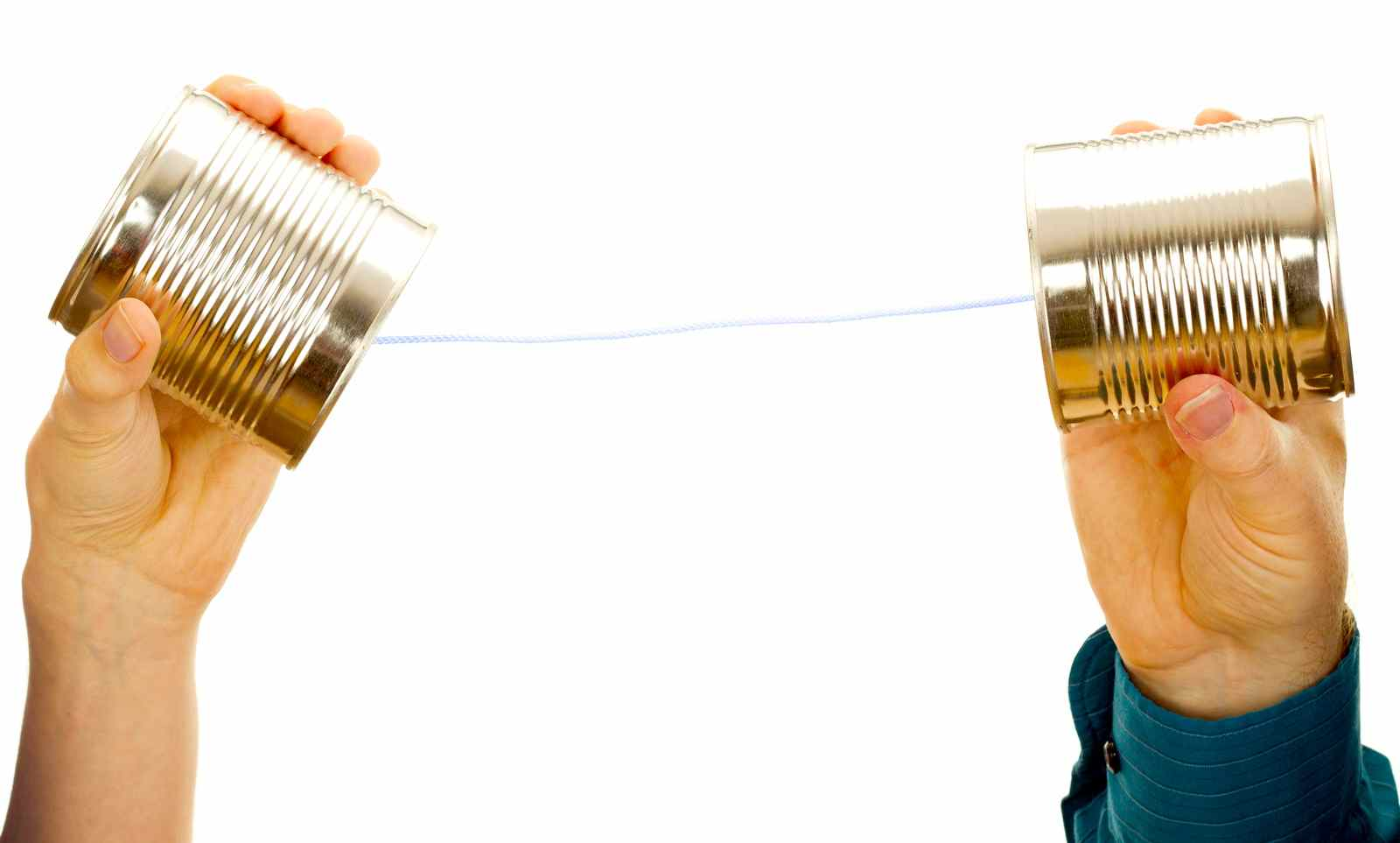 Two Hands Holding Tin Cans Connected by String.jpg