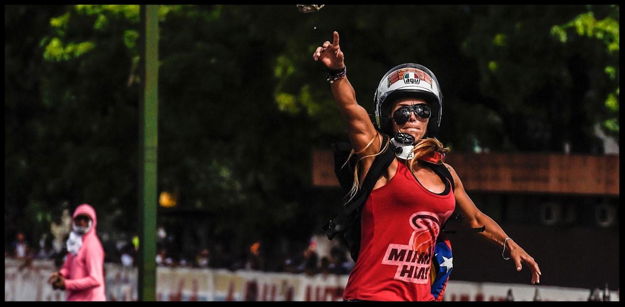 "Fit Venezuelan Protestor. Now known as ""Venezuelan Wonder Woman."""