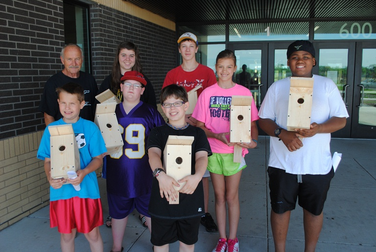 Pictured with their birdhouses, front from left: Isaac Breitling, Nathan Burckhard, Sean Carlson, Kennedy Gravelle and Cooper Folkestad; back from left: Mike Holzer, instructor; Jessica Wood and Wyatt Fitzsimmons, Wadena Summer Rec employees, who assisted students with building their birdhouses.