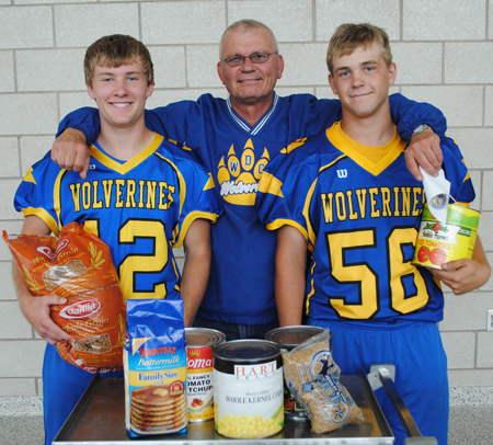 WDC football players are taking off their pads and helmets for a good cause. Head coach Howie Kangas, middle, is flanked by senior players, Nick Carlson and Wyatt Weber.