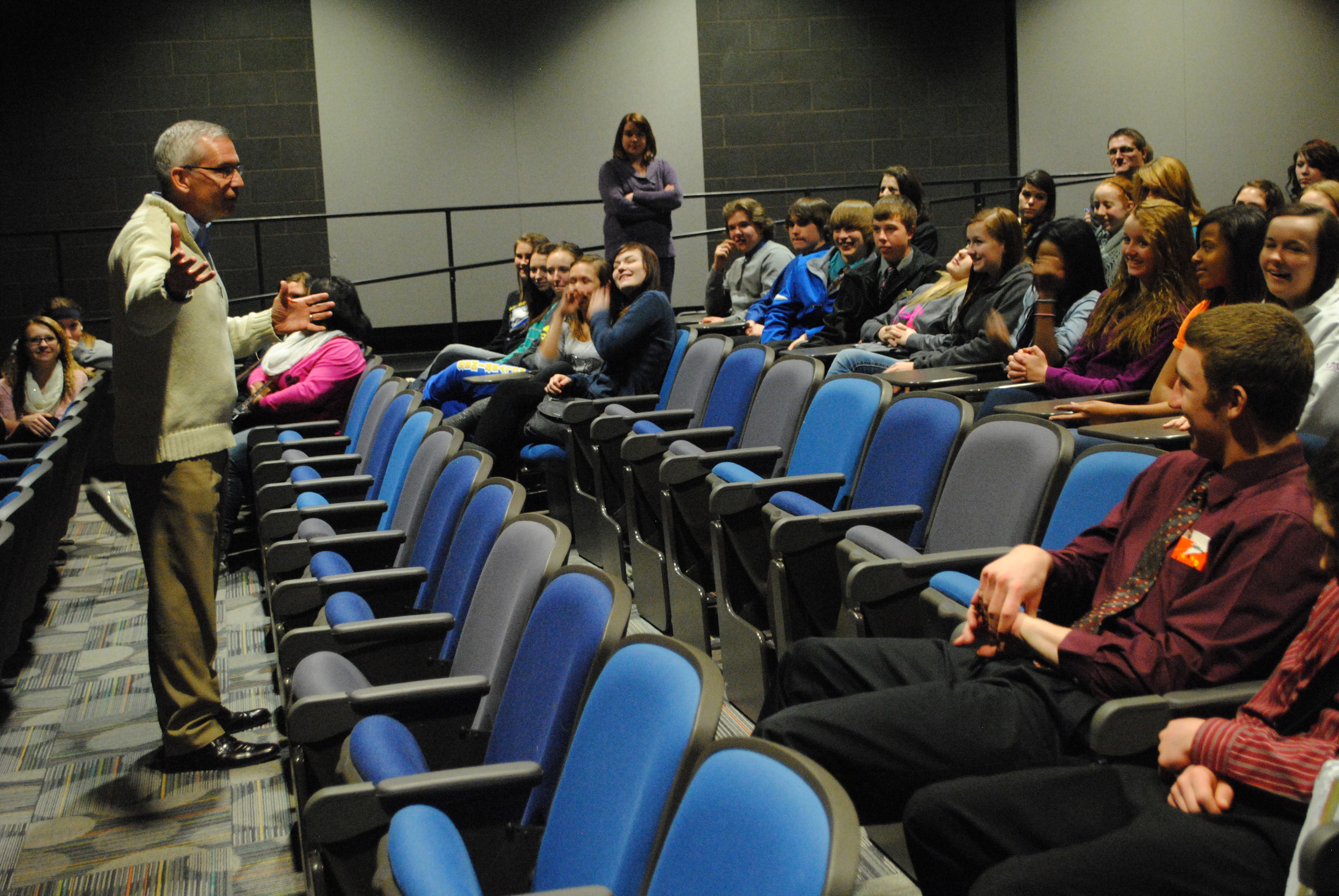 Wadena-Deer Creek High School sophomores listen to Craig Lindvahl give an engaging and at times, humorous presentation on the CEO program Thursday in the Robertson Theatre. (Photo by Dana Pavek, WDC Schools)