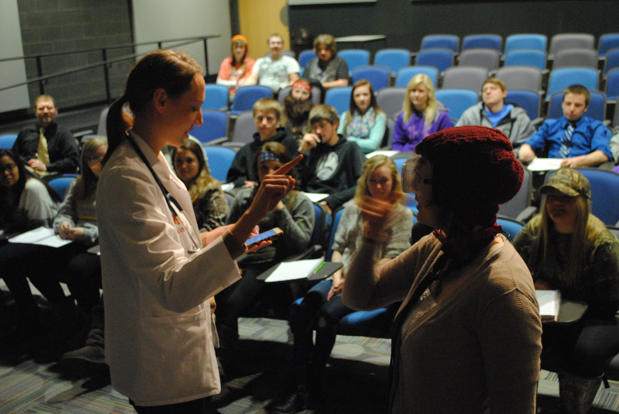University of Minnesota-Duluth medical student Britta Knutson conducts a brain exercise with WDC student Katelyn Windels Tuesday in Robby Grendahl's psychology class. (Photos by Dana Pavek, WDC Schools)
