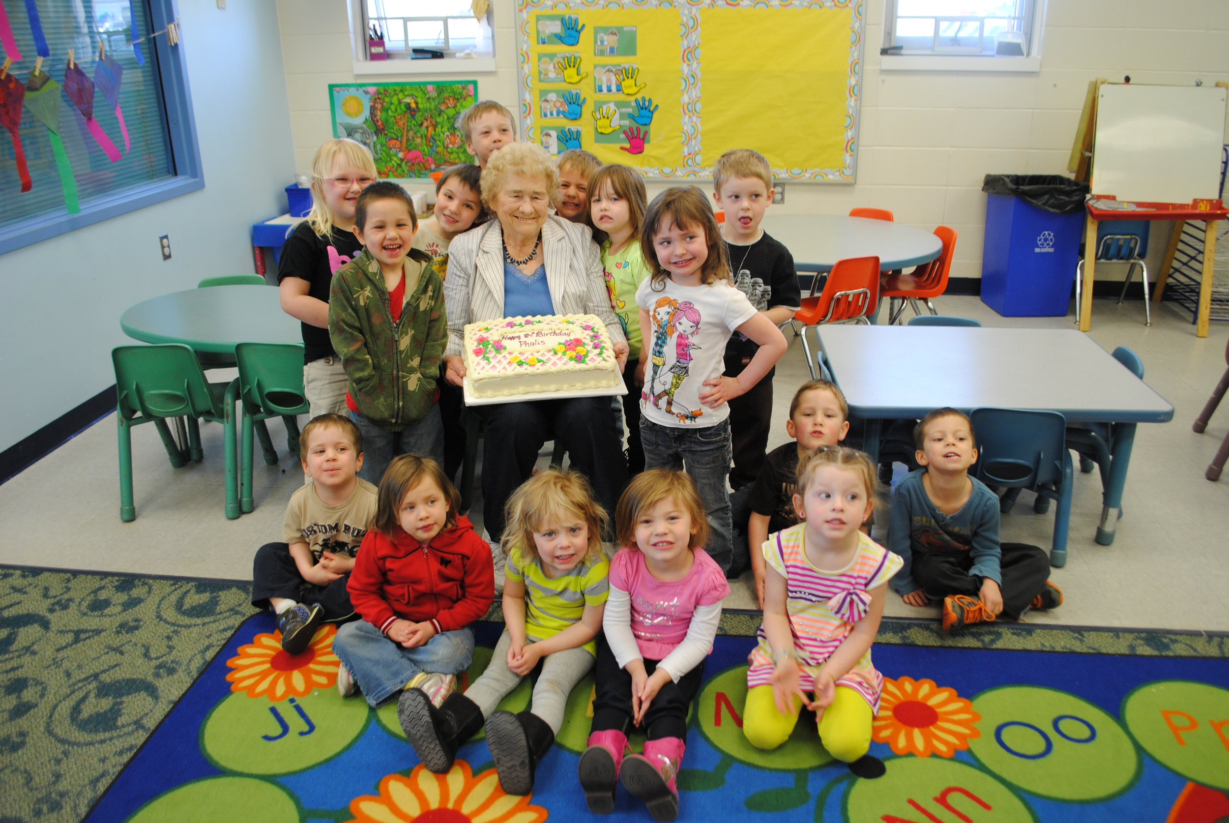 Foster Grandparent Phyllis Jackson celebrated her 84th birthday with WDC Little Kids Club at M State on Thursday. The kids presented Grandma Phyllis with a homemade card and lots of birthday hugs. (Photo by Dana Pavek, WDC Schools)