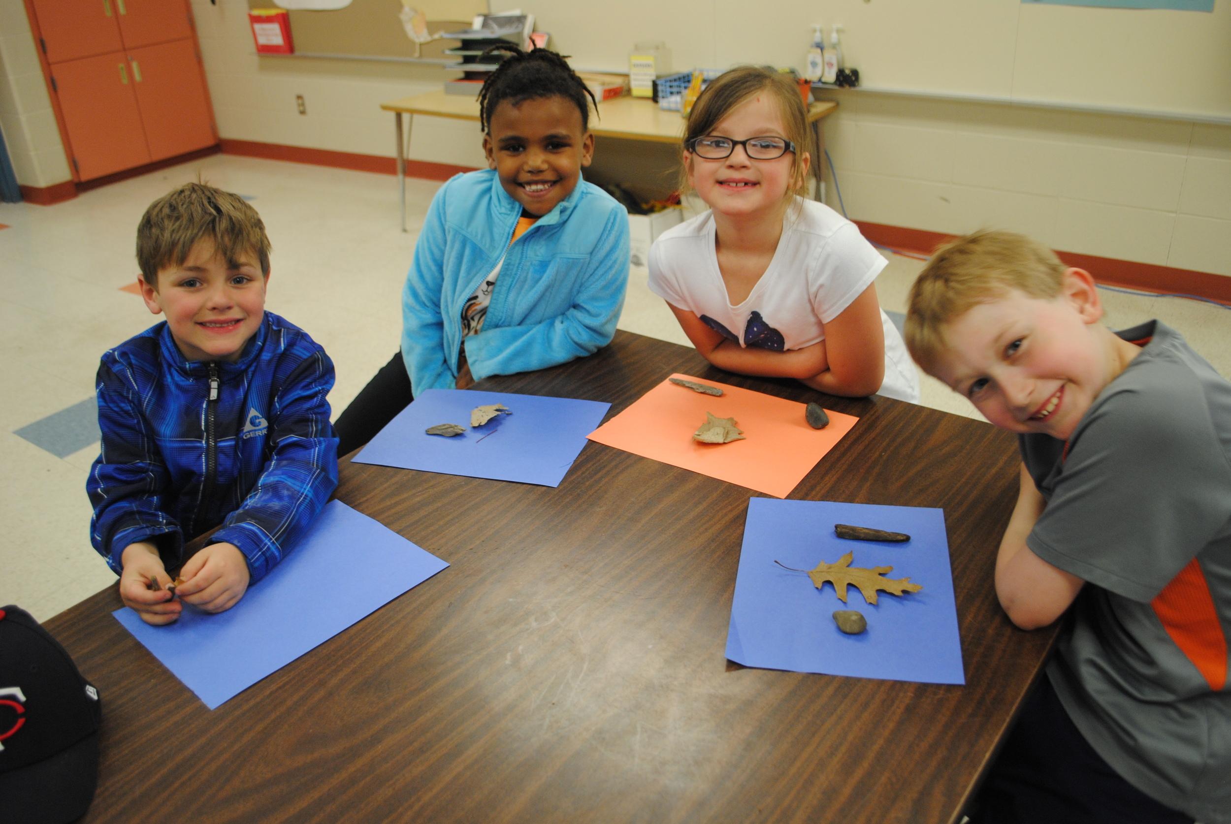 "Jack VanBruggen, Amsale Loer, Brianna Yglesias and Lane Hoefs work on their ""sun fades"" during their After-School Green Adventures class."