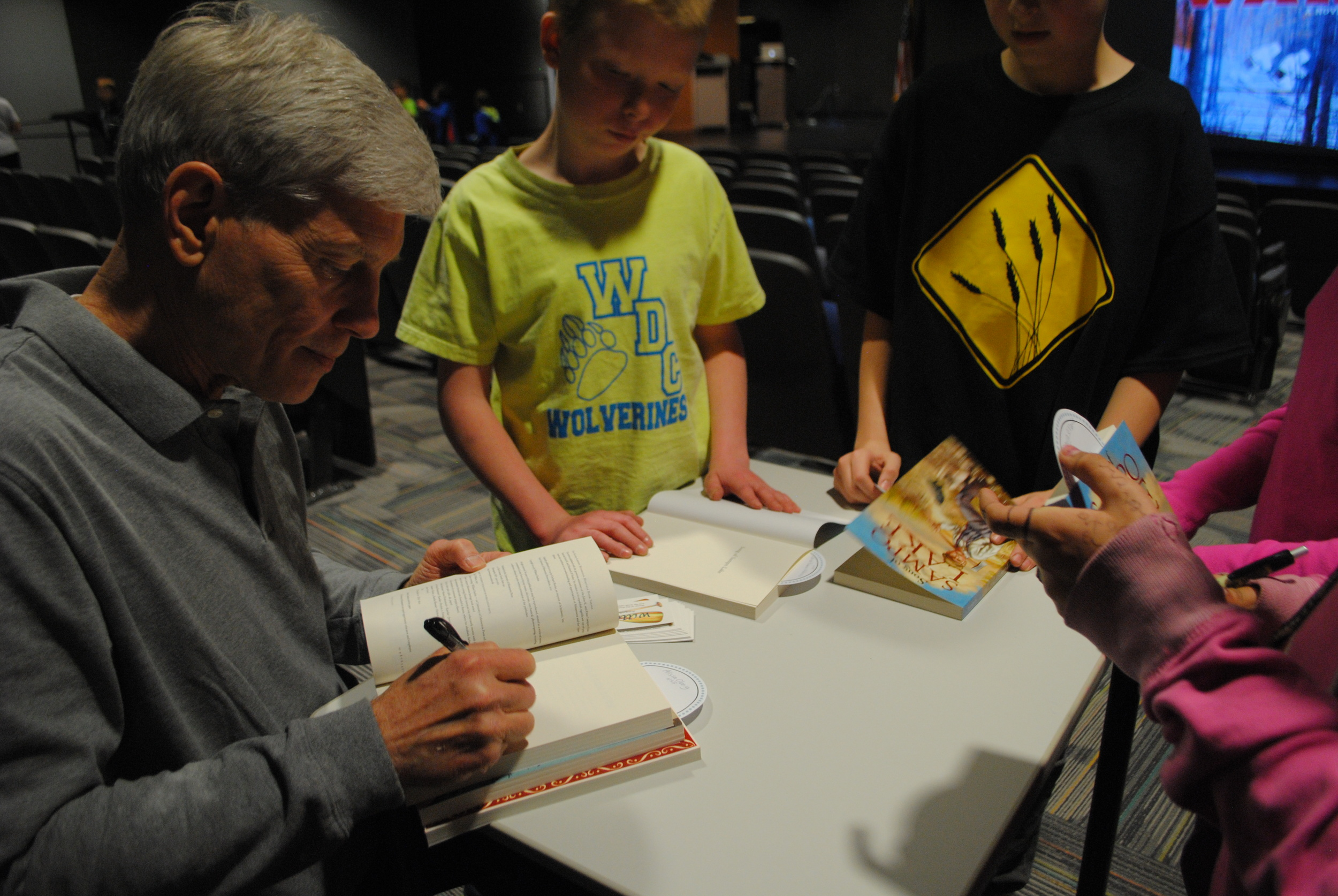 Durbin signing books for WDC students, who were excited to visit with the author one-on-one.