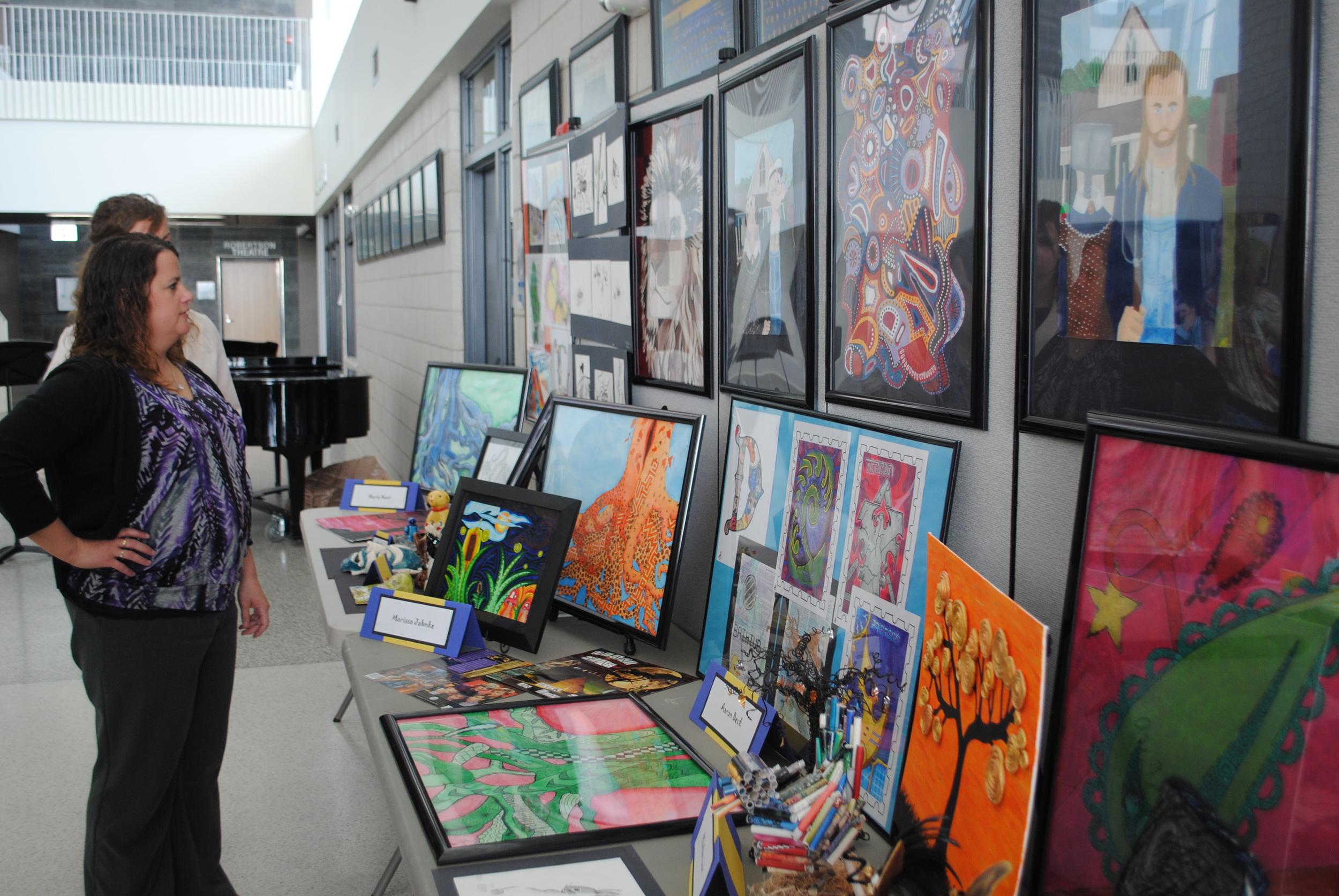 At the fine arts banquet, WDC Visual Arts Teacher Laurie Kopischke-Pulju set up an interesting display of students' artwork for parents to enjoy.
