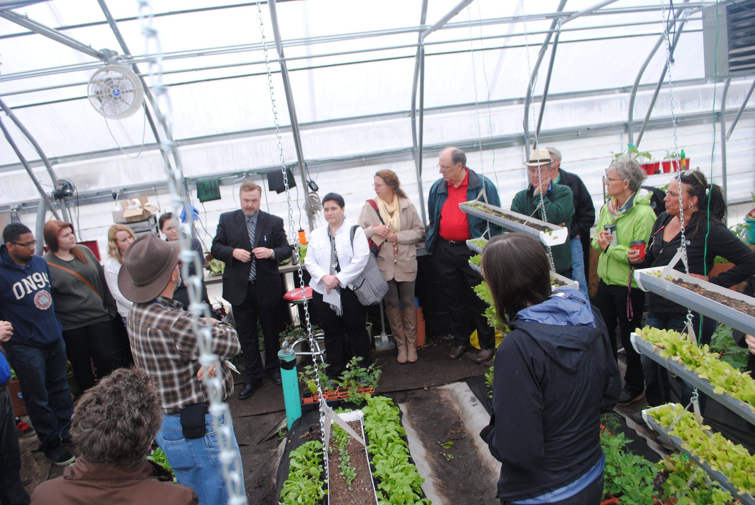 WDC Superintendent Lee Westrum (fifth from left) talks about the funding sources involved in making the greenhouse a viable and successful venture for the school. (Photo by Dana Pavek, WDC Schools)