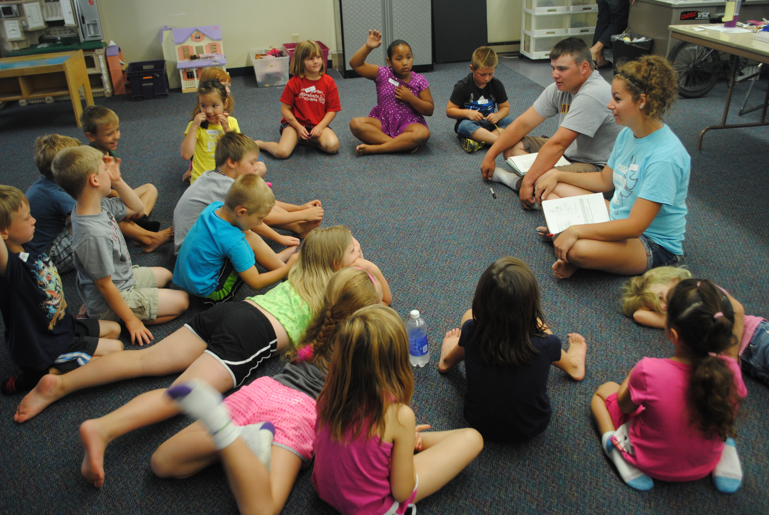 Joey Price and Abby Wegscheid, at right, visit with the younger WDC Kids Club youth on July 22 about appropriate touches.
