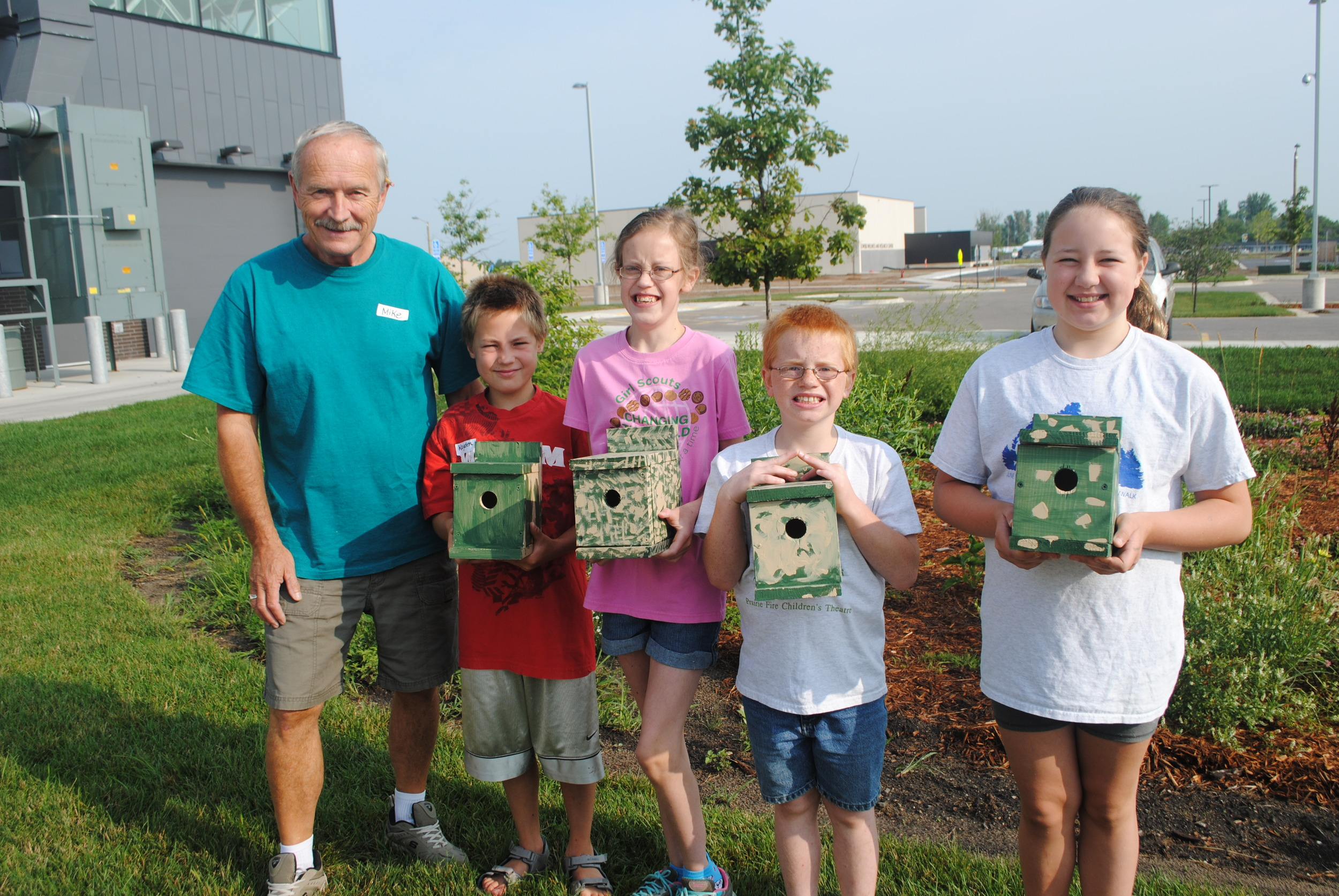 Youth proudly hold their wren houses they built and painted in the WDCB Community Education enrichment class on Aug. 5 and 6, from left: Instructor Mike Holzer, Kayden Stinar, Alyssa Heltemes, Ron Bernu and Kaylin Lupkes. The kids also built a bluebird house. (Photos by Dana Pavek, WDC Schools)