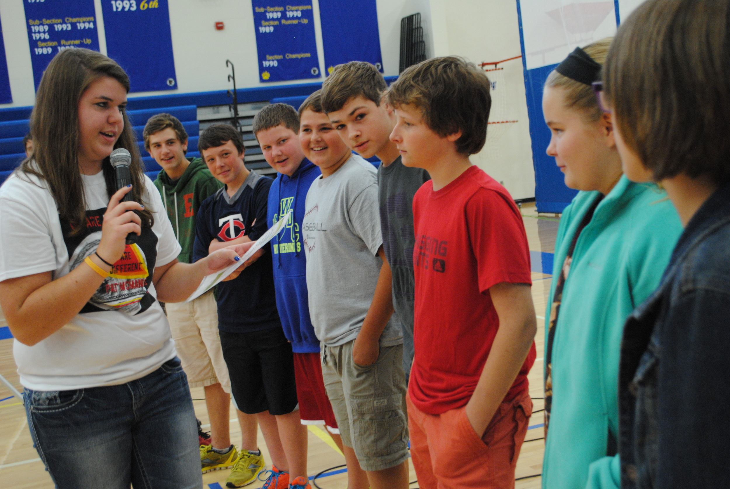 WDC High School mentor Jessica Wood leads a skit about assertiveness with a small group of junior high students.