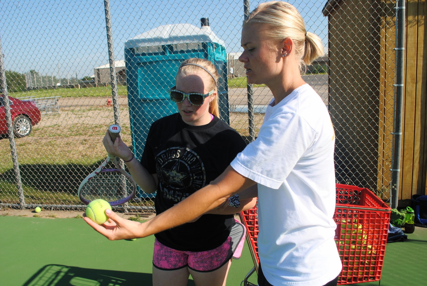 Coach Wahlin giving Sarah Moen pointers at practice. (Photo by Dana Pavek, WDC Schools)
