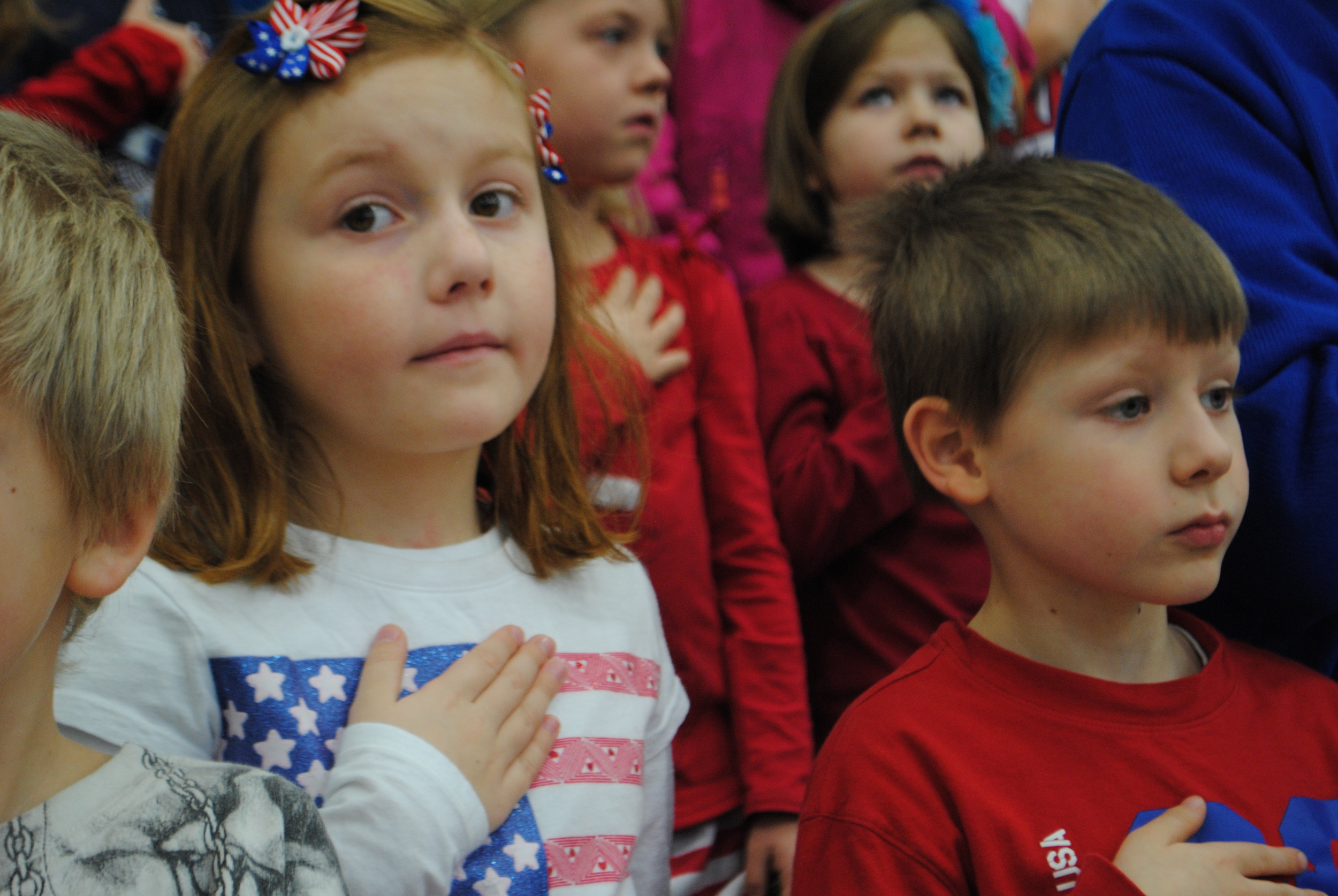 WDC Kindergarten students Emma Weniger and Johnathan Hockert put their hands over their hearts during the Pledge of Allegiance at WDC Veterans Day program held today at WDC Middle/High School Gym. WDC's Veterans Day program teaches WDC students the importance of patriotism and gratitude for veterans. (Photos by Dana Pavek, WDC Schools)