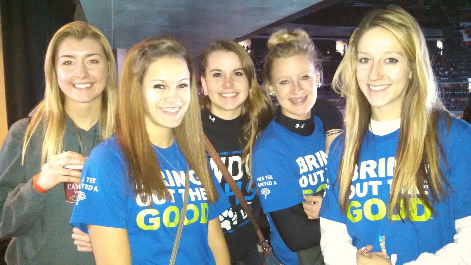 """Wearing their """"Bring Out the Good"""" tees at the We Day rally this morning are WDC students, from left, Carrie Nelson, Autumn Jahnke, Jennifer Craig, Sam Manselle and Danyel Post. (Photo by Rachel Bounds.)"""