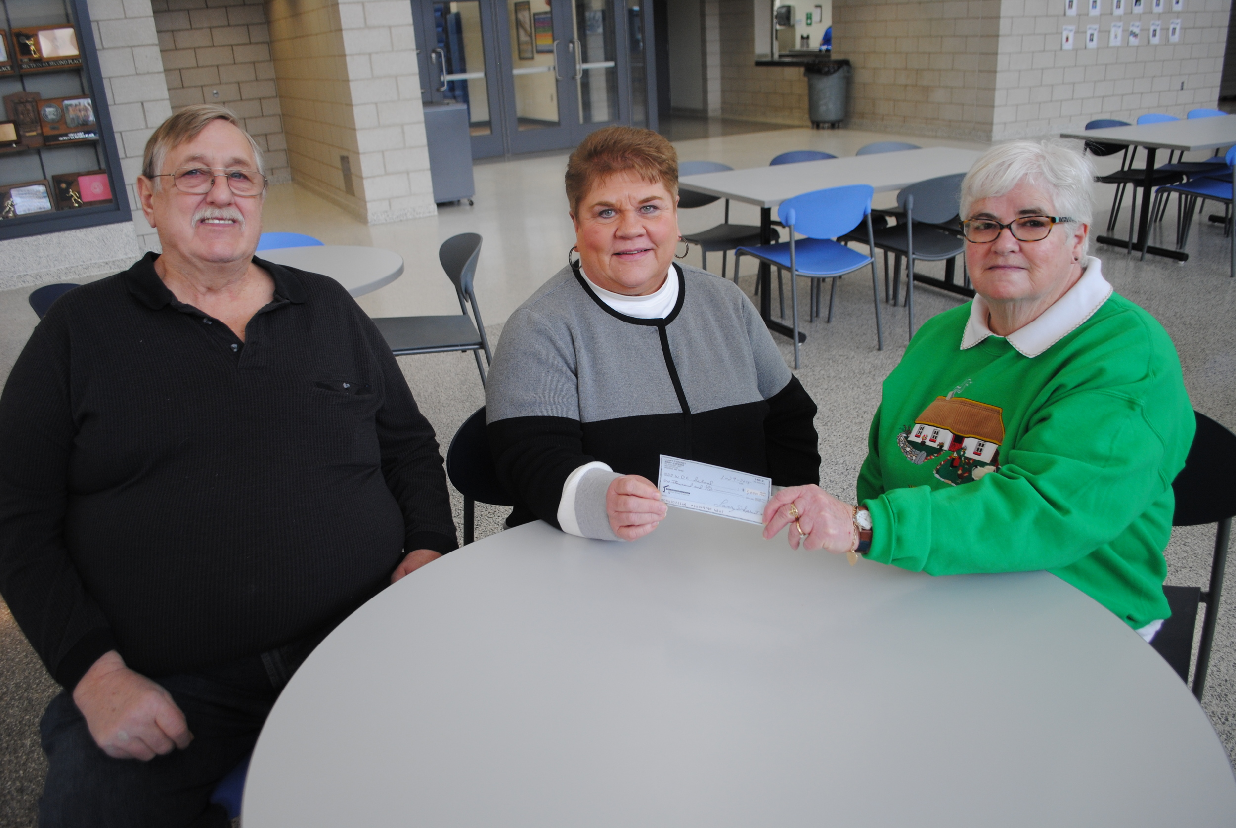WDC School District senior bookkeeper Joyce Boyne, middle, accepts a $1,000 donation from Larry and Judy Spenst of Wadena to establish a scholarship endowment for graduating special education students at WDC High School.  (Photo by Dana Pavek, WDC Schools)