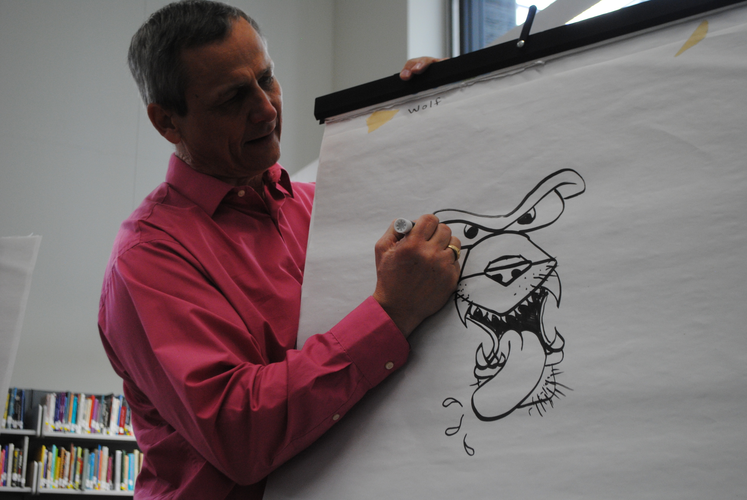 Illustrator/author Gary Harbo shows sixth-grade students how to draw a brow on a wolf during his artist-in-residence visit Thursday, Feb. 5 in the WDC Middle/High School Media Center. Students enjoyed learning cartoon-like drawing techniques from Harbo. (Photos by Dana Pavek, WDC Schools)