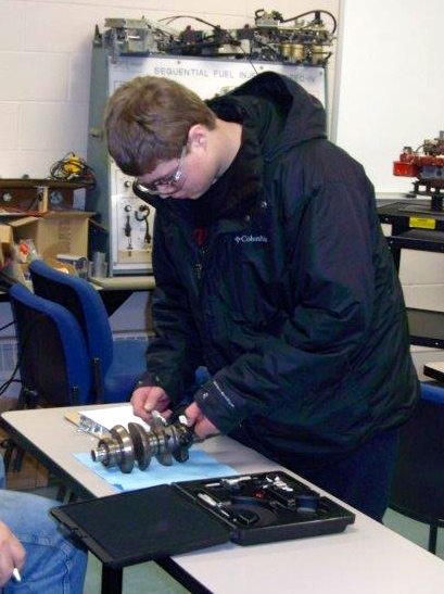 WDC FFA member, Ethan Benson, measures engine parts during the Minnesota FFA Region II Agricultural Mechanics Career Development Event. (Photo by Richard Muckala, WDC Schools)
