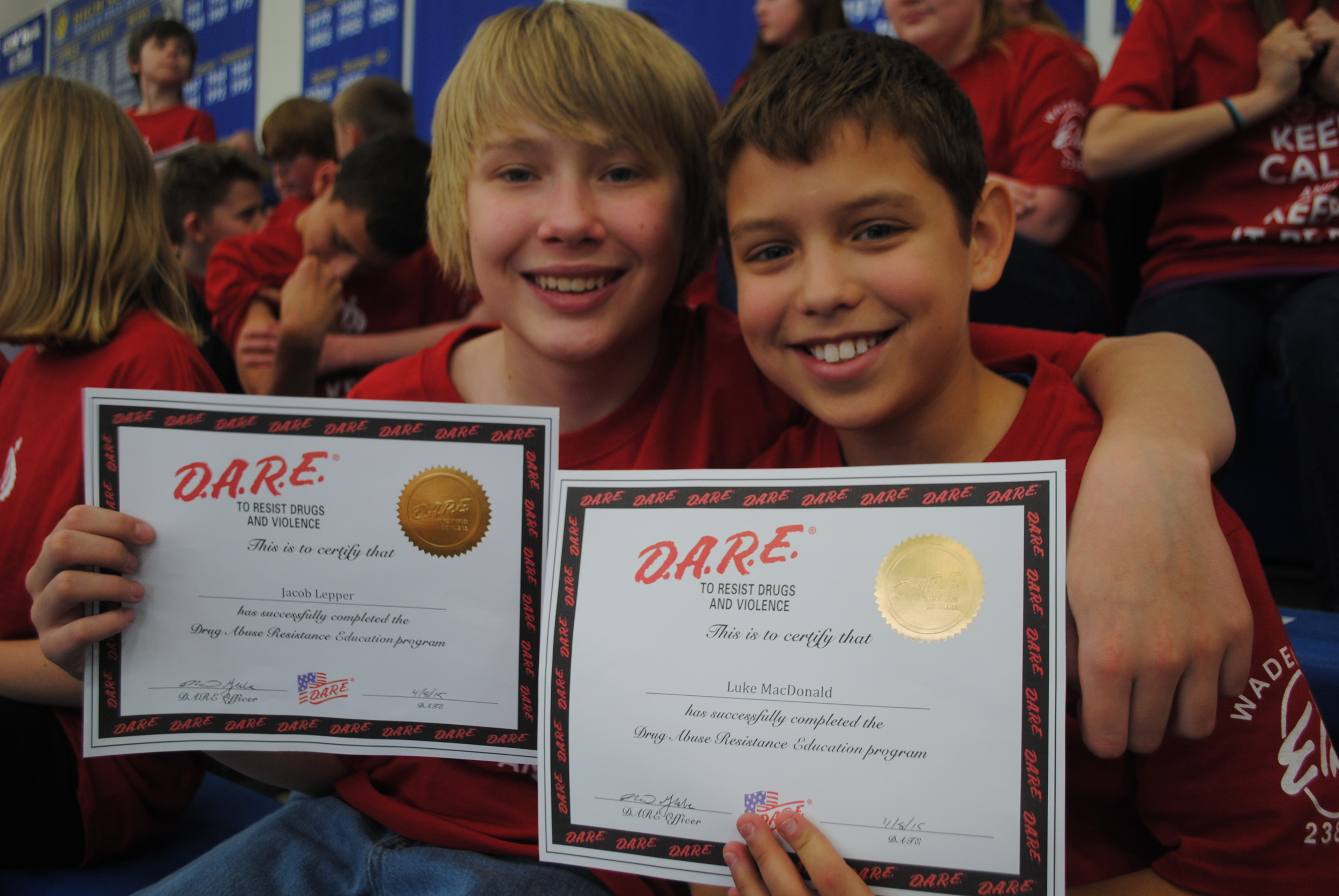 Jacob Lepper and Luke MacDonald proudly show their D.A.R.E. graduation certificates at the ceremony.