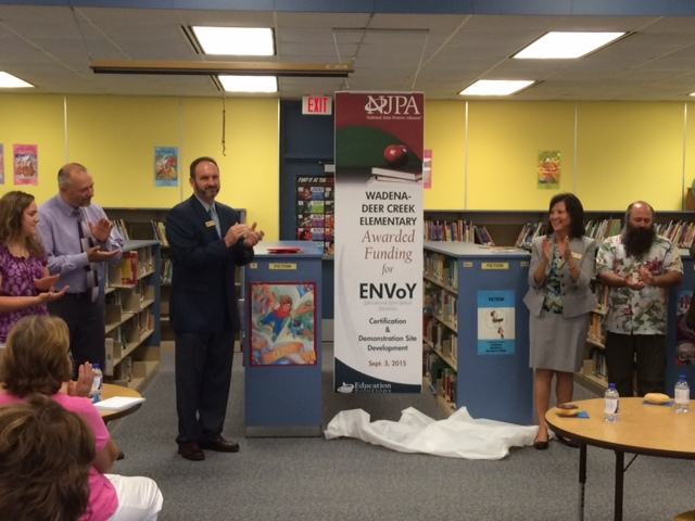 NJPA made the announcement Thursday morning to Wadena-Deer Creek Elementary staff and administration that Wadena-Deer Creek Elementary was awarded funding to serve as an ENVoY certification and demonstration site. Pictured above at the unveiling of the ENVoY banner, from left, Tracy Fruechte, first-grade teacher; Louis Rutten, elementary principal; Paul Drange, NJPA Director of Regional Programs; Rynell Schock, NJPA Leader of Education Services; and Dan Savoie, third-grade teacher.