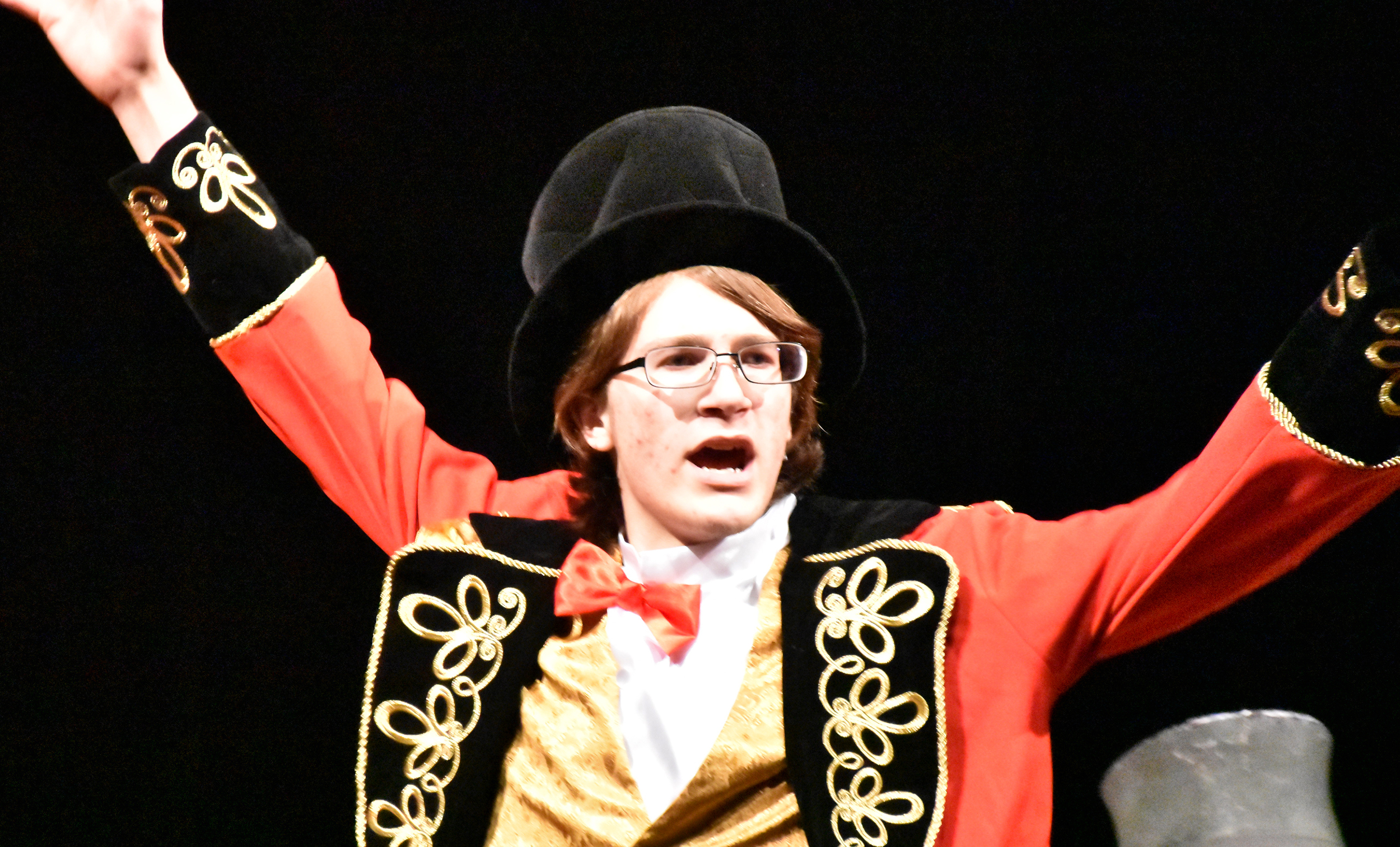 Stephen Spilman portrays Burnum, he ringmaster and owner of Burnum and Bailout Traveling Circus, who's something of a con man too.