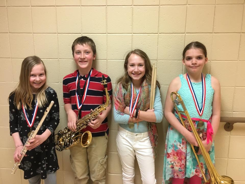 WDC fifth-grade band students performing at the band festival in Fergus Falls, from left: Kelanie Oldakowski, Simon Kreklau, Libby Hartman, and Alycyn Swanson.