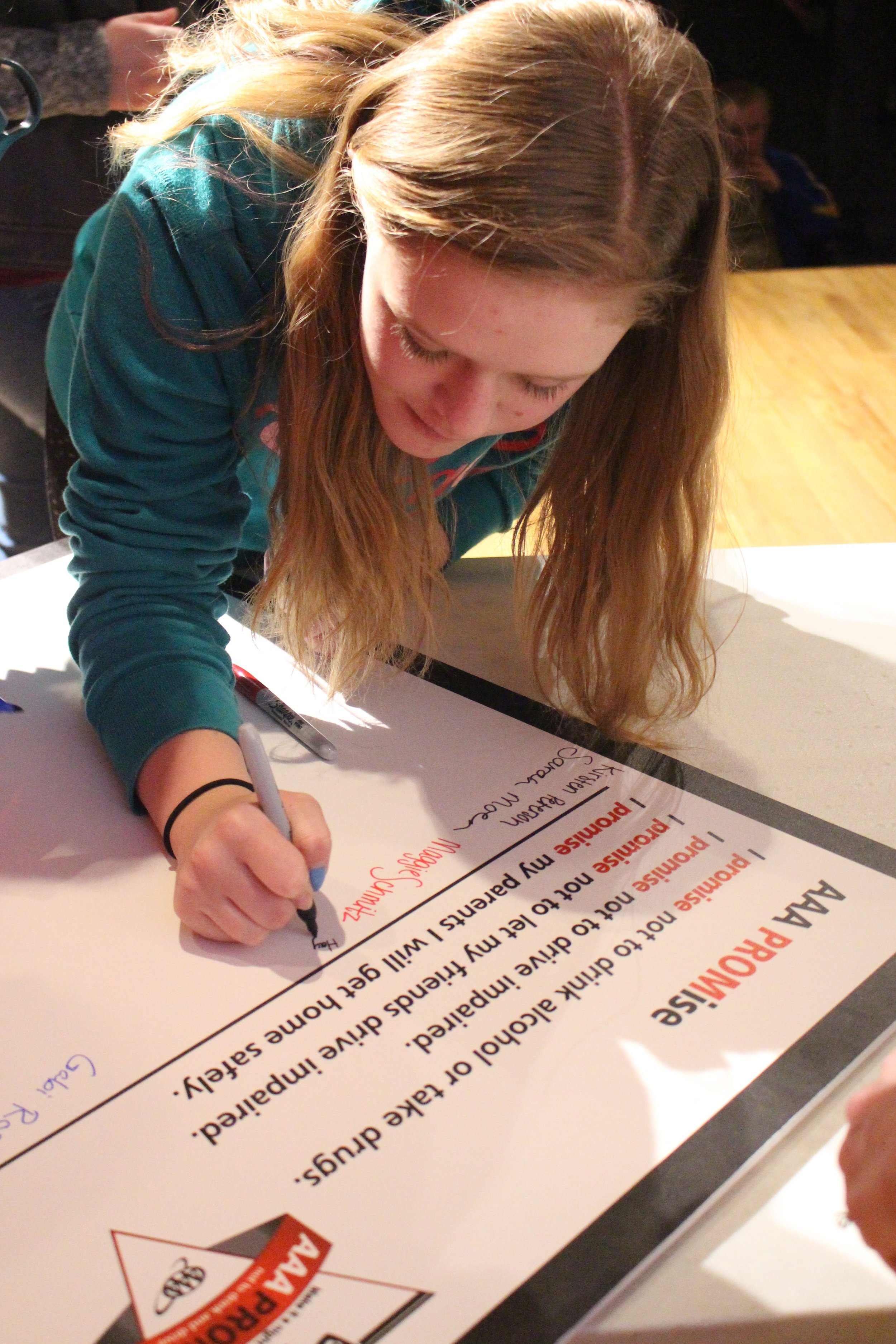 WDC students signed a pledge to not drink and drive after Langer's presentation.