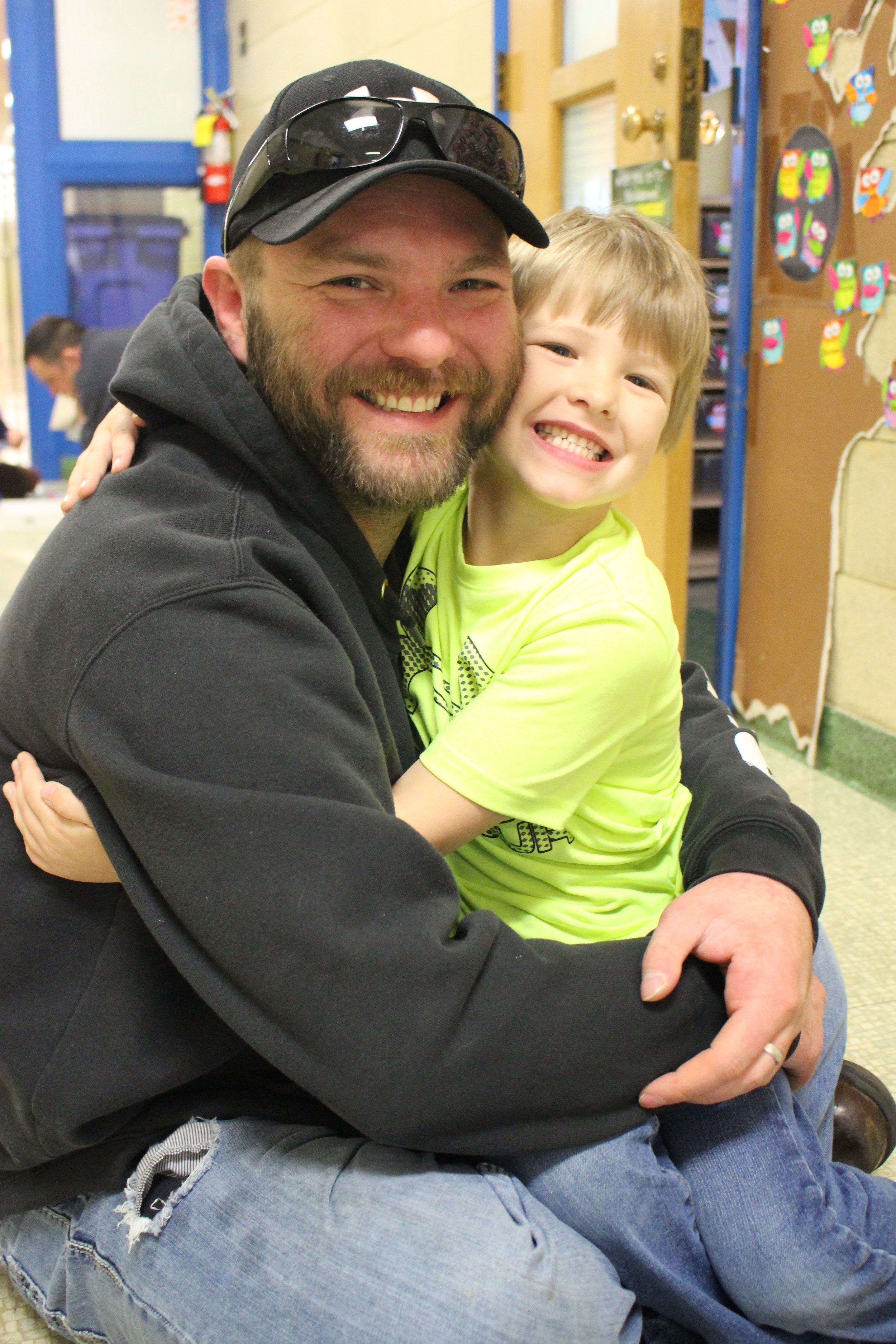 "WDC kindergartener Braxton Moore hugs his dad, Jason, during the 4th annual ""Donuts for Dads"" at Wadena-Deer Creek Elementary."