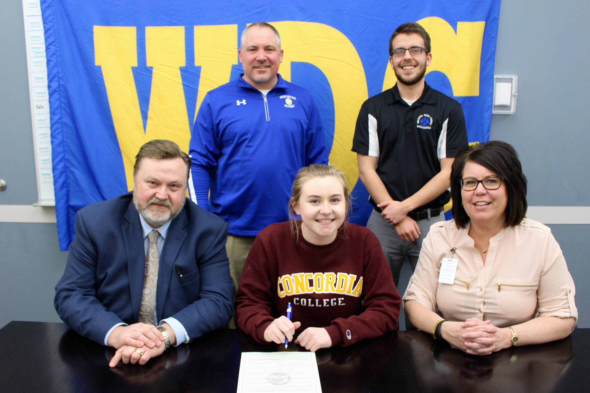 At the signing this week, Abby Westrum (center) is surrounded by her parents, Lee and Jennifer Westrum, as well as Norm Gallant, WDC Activities Director (left) and Jordan Cresap, WDC Girls' Tennis Coach. (Photos by Dana Cantleberry, WDC Schools)