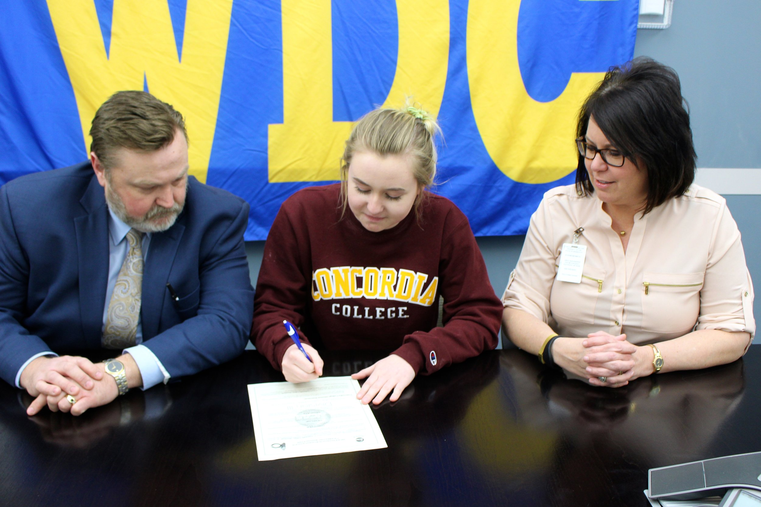 Big day for Abby Westrum! She signed her letter of intent this week to play tennis at Concordia College in Moorhead. Her proud parents, Lee and Jennifer Westrum, witness the signing.