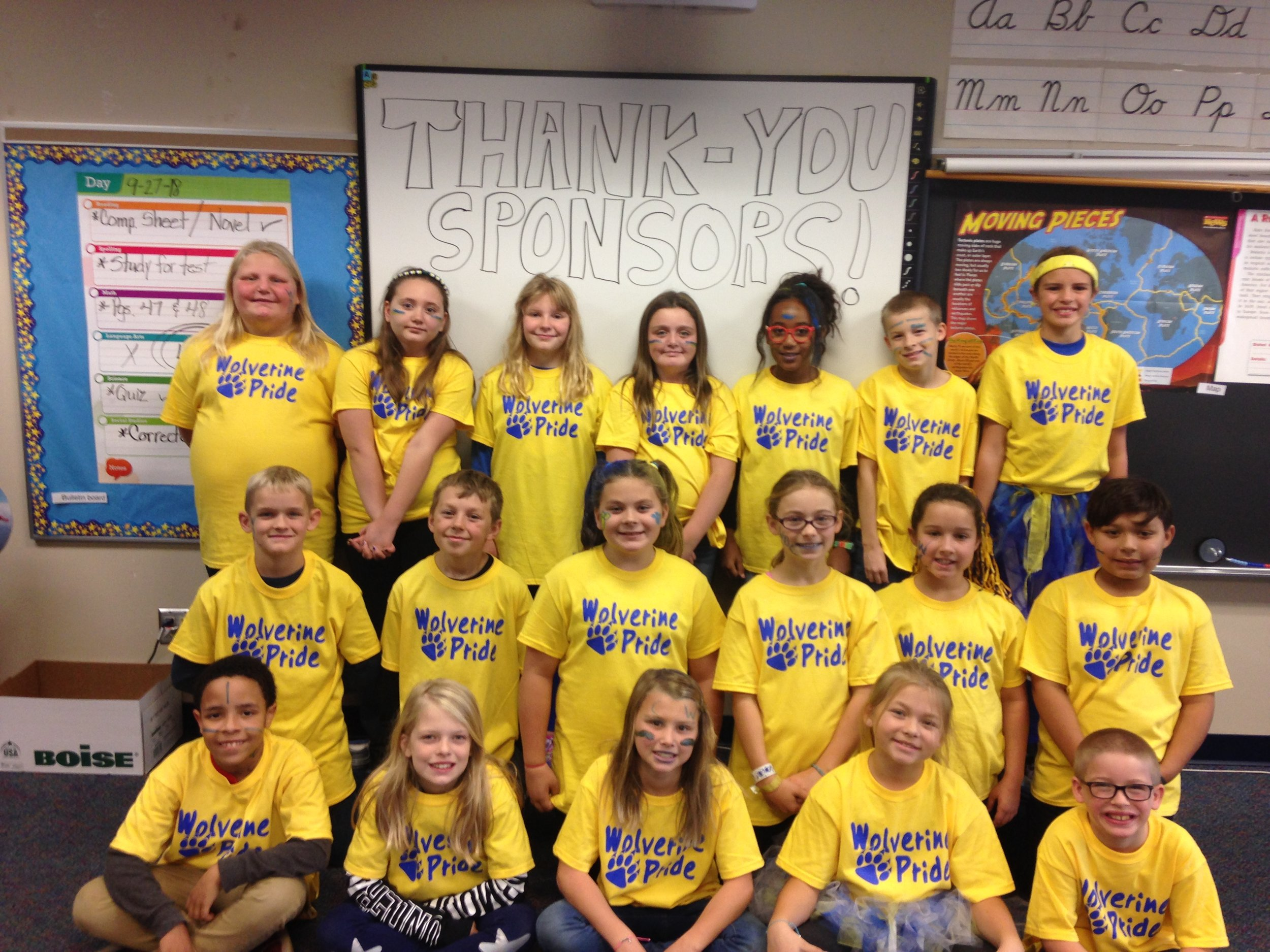 Mrs. Berg's fourth-graders looking sharp in their new Wolverine Pride T-shirts! They also posted a thank you on their erasable whiteboard.