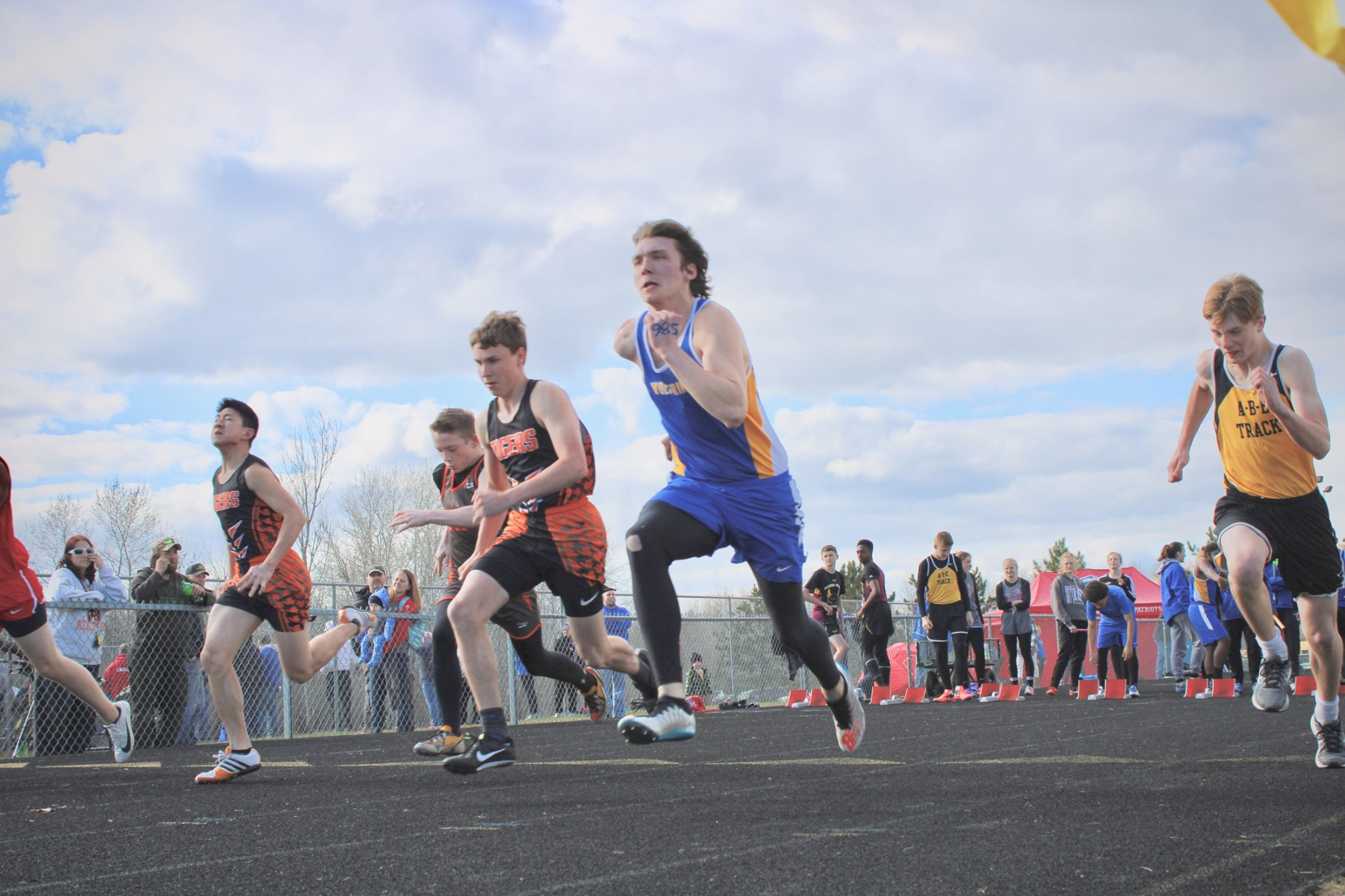 Hawkins (in blue and gold) returning to track last week where he competed in the Sam Kelderman Memorial Meet in the 100-meter dash (above). He ended up 4th overall with a time of 11.66 — an amazing time! Photo by Chelsey Jo Dagen, WDC Schools.