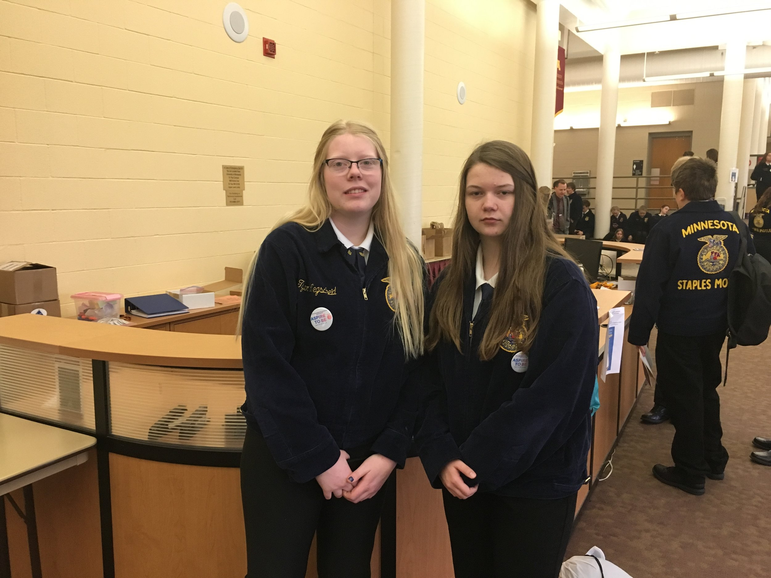 WDC FFA members Morgan Grangruth, left, and Makaylyn Sibert served as Courtesy Corp and Delegates at the 90th Minnesota FFA Convention in Minneapolis. Photo by Richard Muckala, WDC FFA advisor.